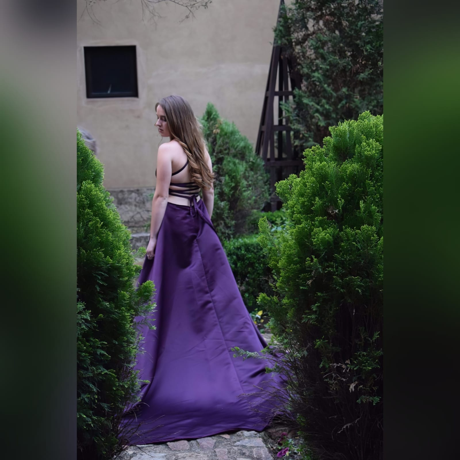 Plum long flowy prom dress with a plunging neckline 9 plum long flowy prom dress with a plunging neckline and a lace up open back with a slit and train.