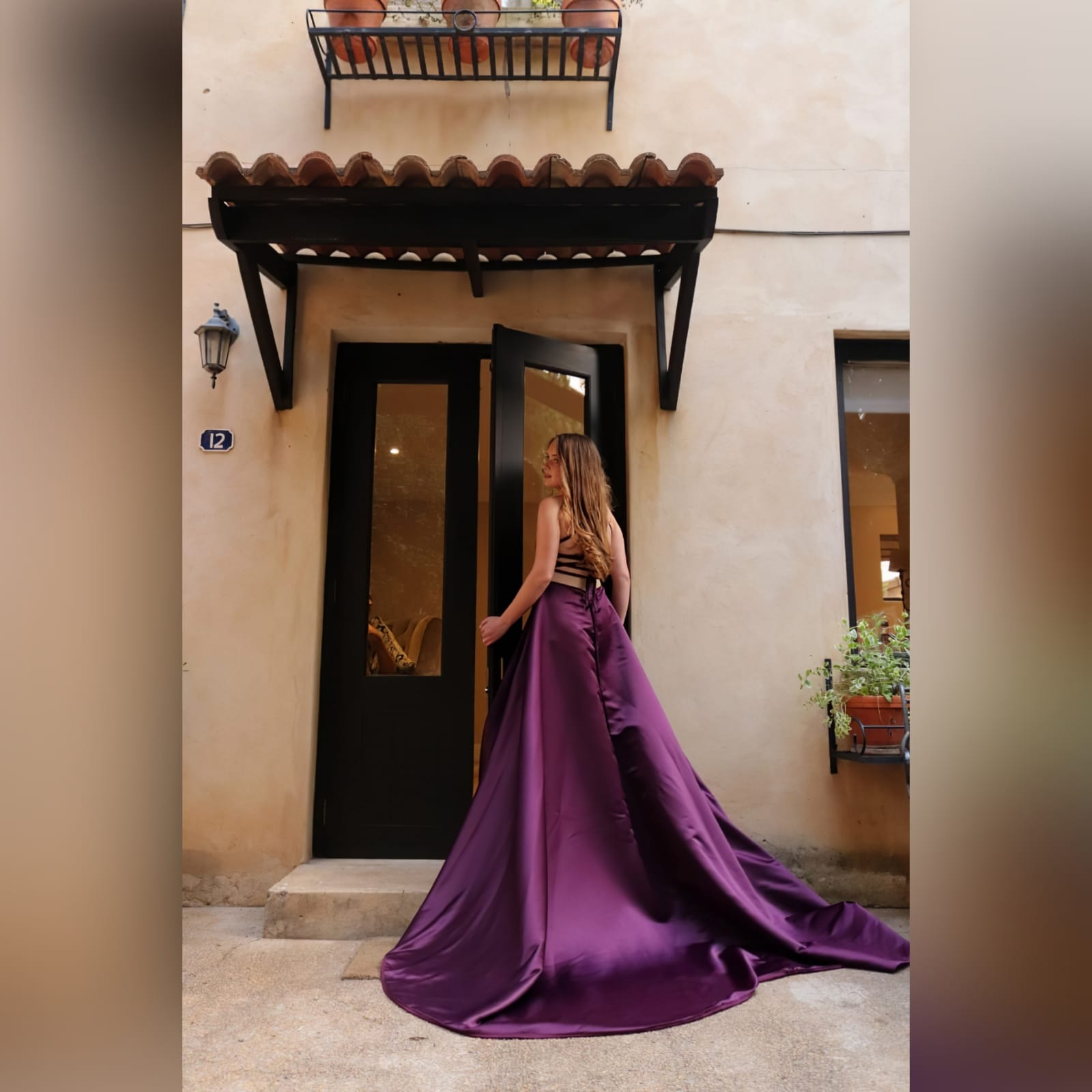 Plum long flowy prom dress with a plunging neckline 5 plum long flowy prom dress with a plunging neckline and a lace up open back with a slit and train.