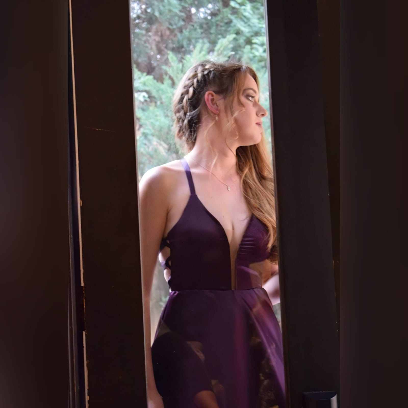 Plum long flowy prom dress with a plunging neckline 3 plum long flowy prom dress with a plunging neckline and a lace up open back with a slit and train.