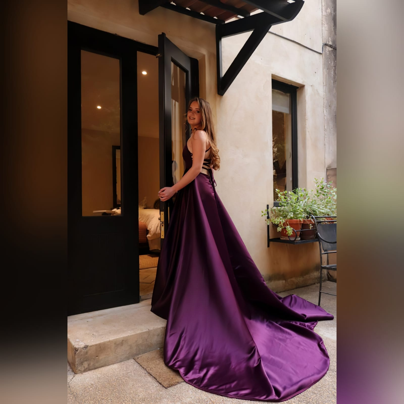 Plum long flowy prom dress with a plunging neckline 1 plum long flowy prom dress with a plunging neckline and a lace up open back with a slit and train.