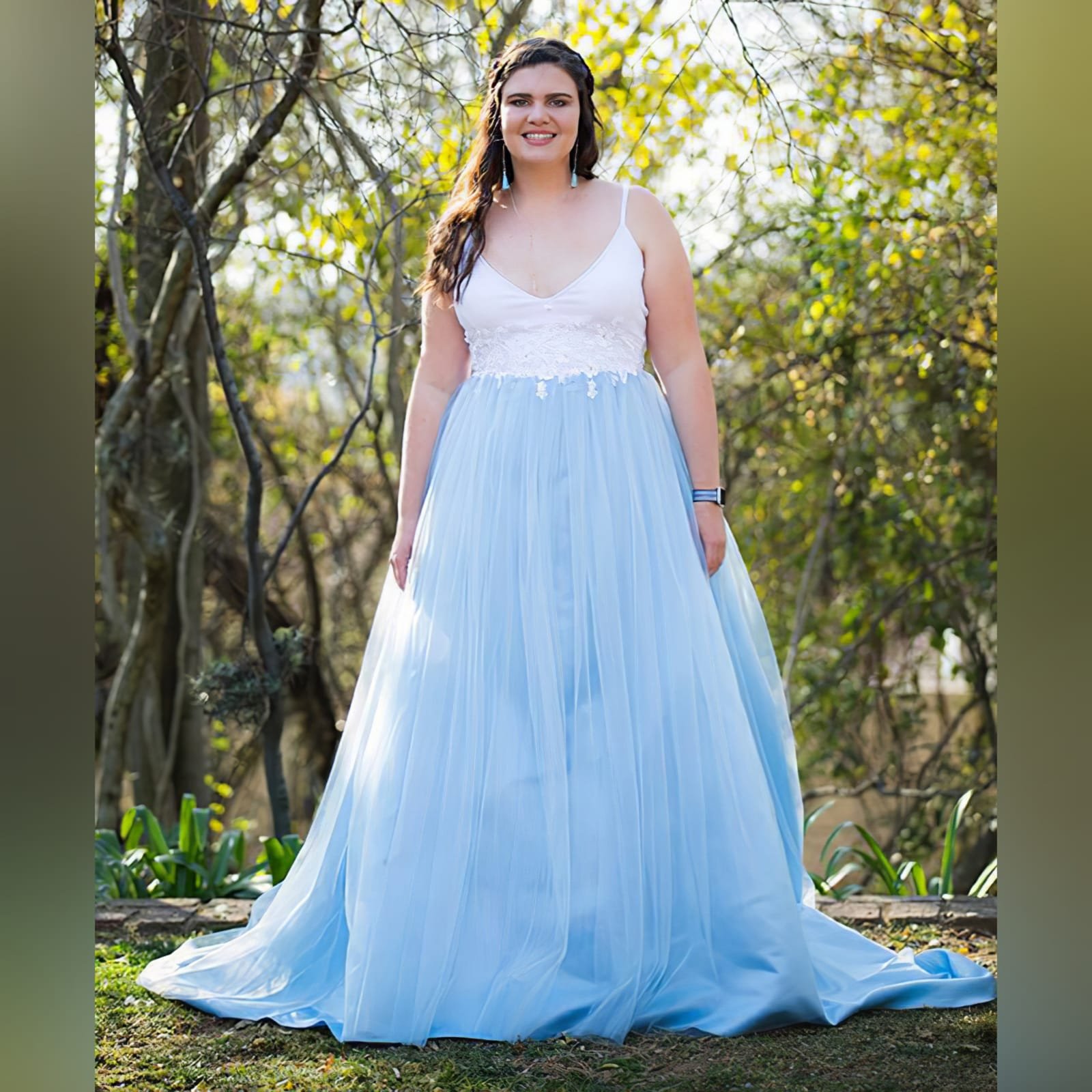 Powder blue and white prom ball gown dress 5 powder blue and white prom ball gown dress detailed with white 3d lace and beads with a low back and thin shoulder straps. With a train.