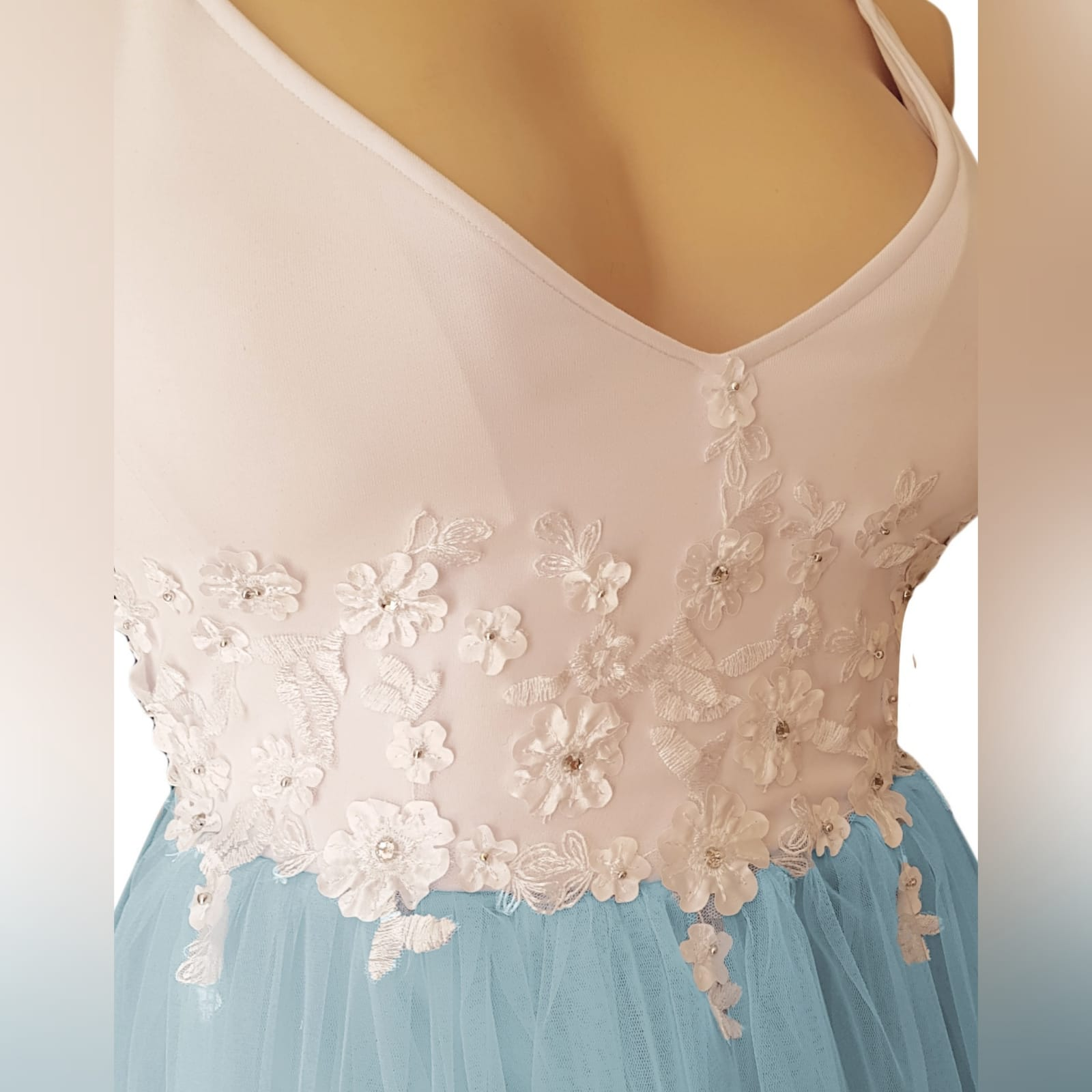 Powder blue and white prom ball gown dress 7 powder blue and white prom ball gown dress detailed with white 3d lace and beads with a low back and thin shoulder straps. With a train.
