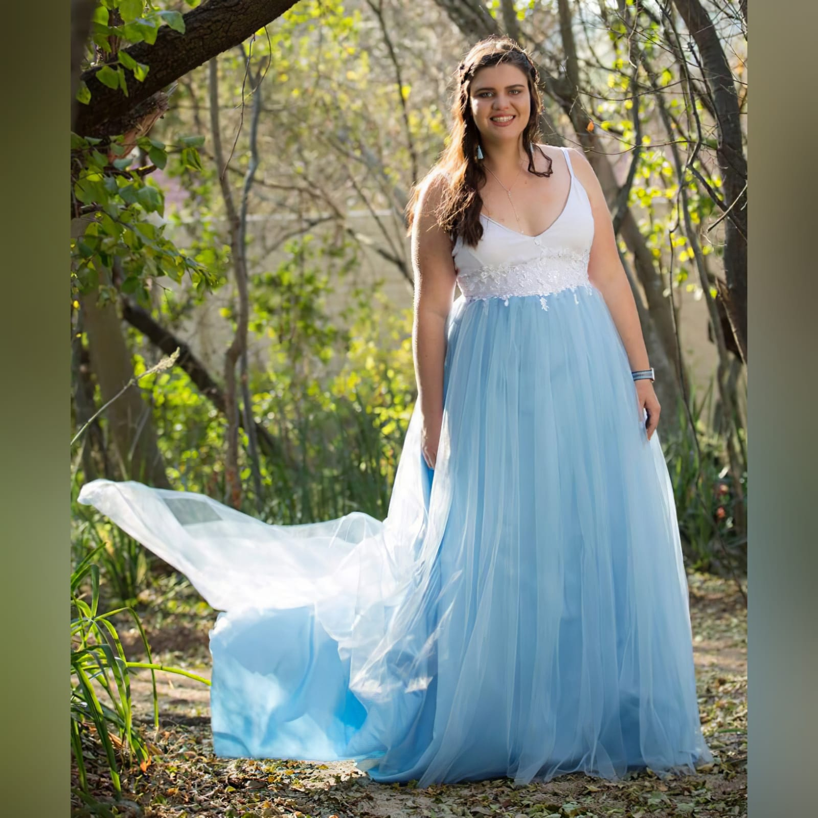 Powder blue and white prom ball gown dress 1 powder blue and white prom ball gown dress detailed with white 3d lace and beads with a low back and thin shoulder straps. With a train.