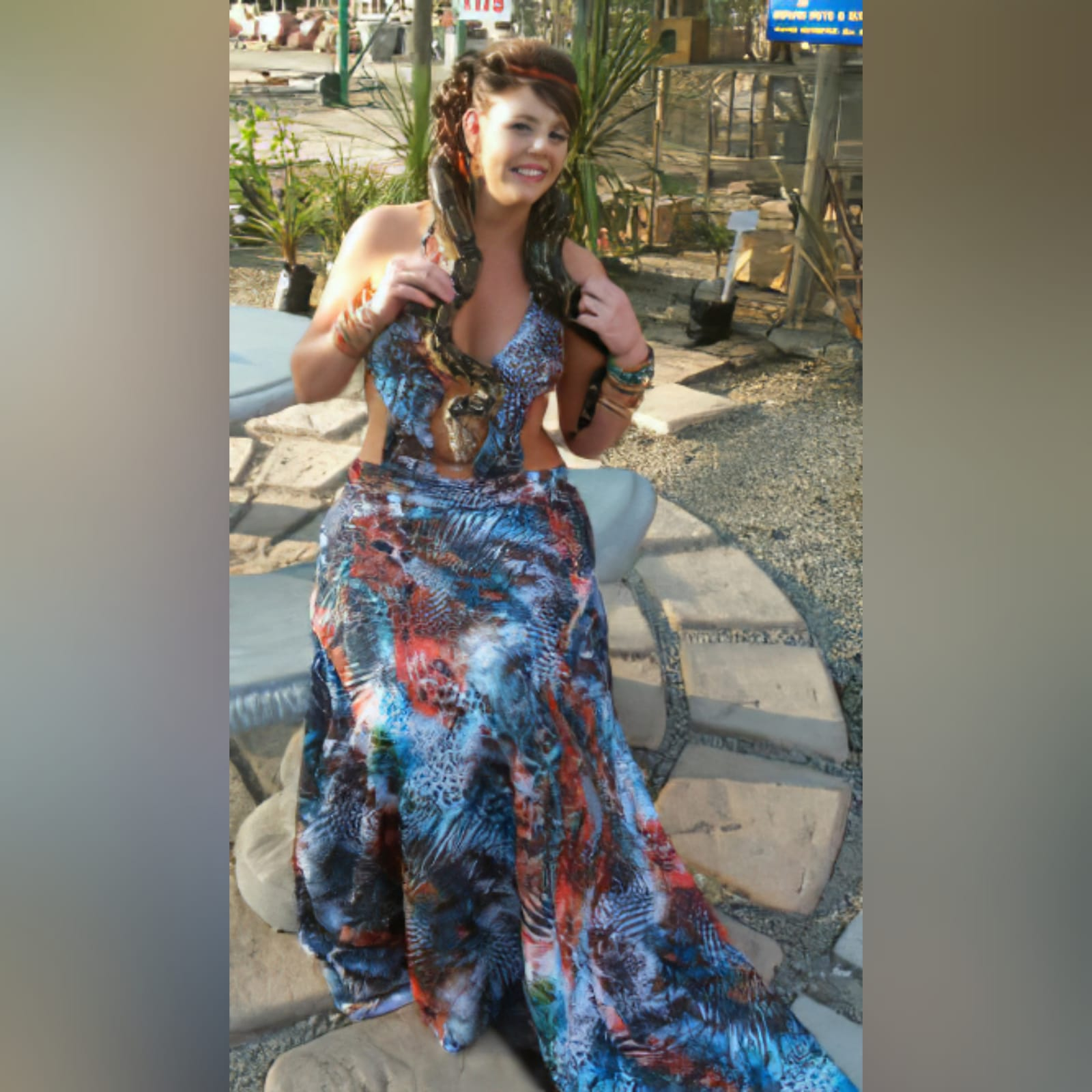 Printed long plunging neckline matric dance dress 2 printed long plunging neckline matric dance dress with a naked back and a train