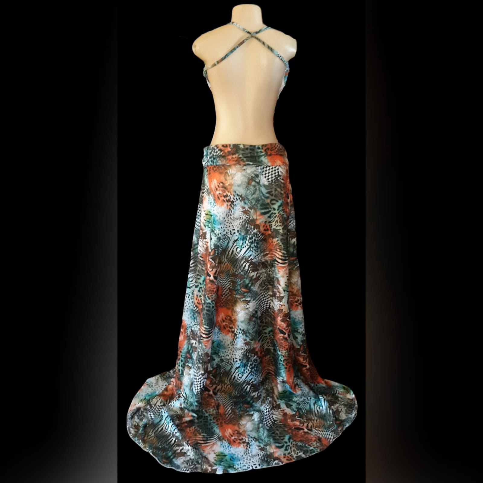 Printed long plunging neckline matric dance dress 4 printed long plunging neckline matric dance dress with a naked back and a train