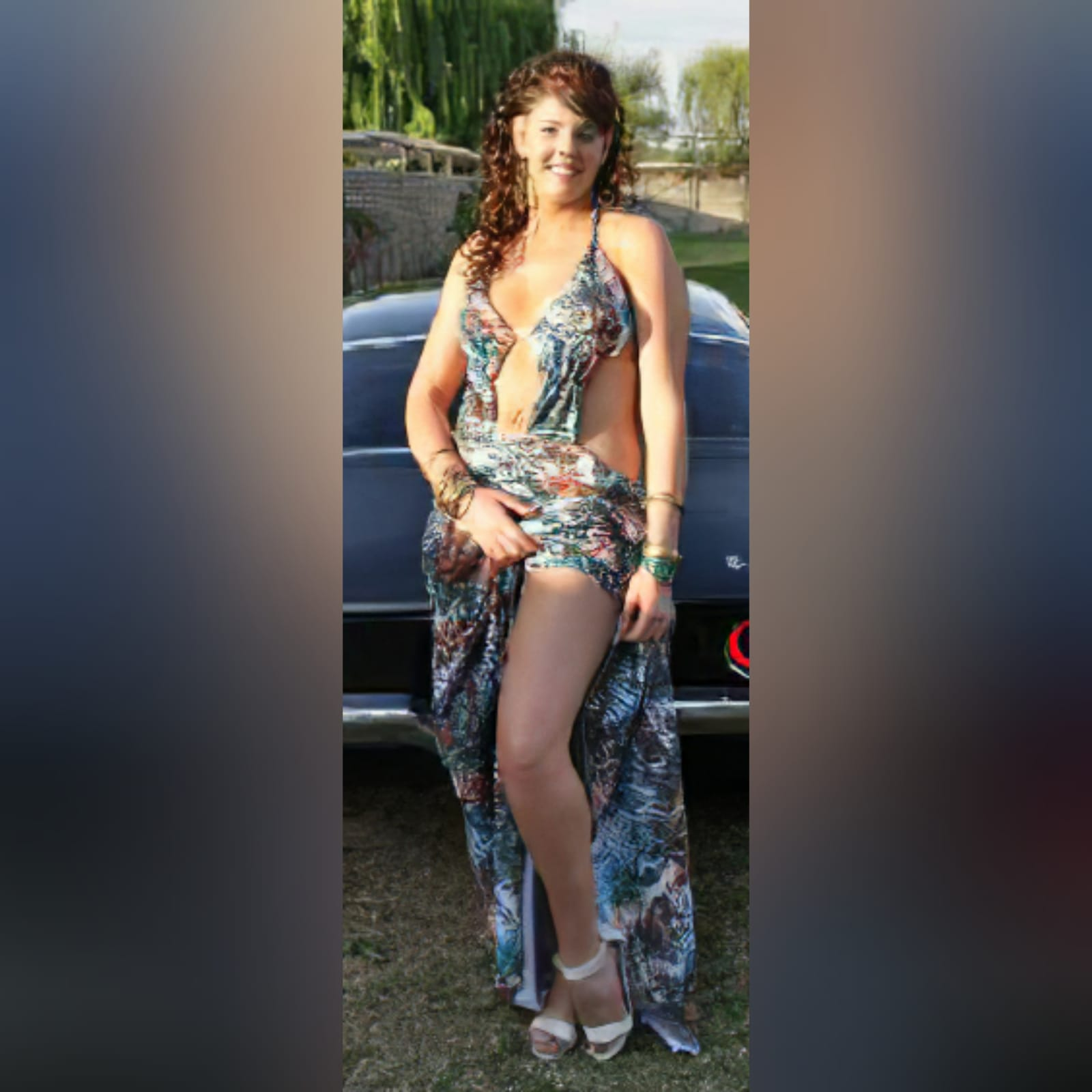 Printed long plunging neckline matric dance dress 1 printed long plunging neckline matric dance dress with a naked back and a train