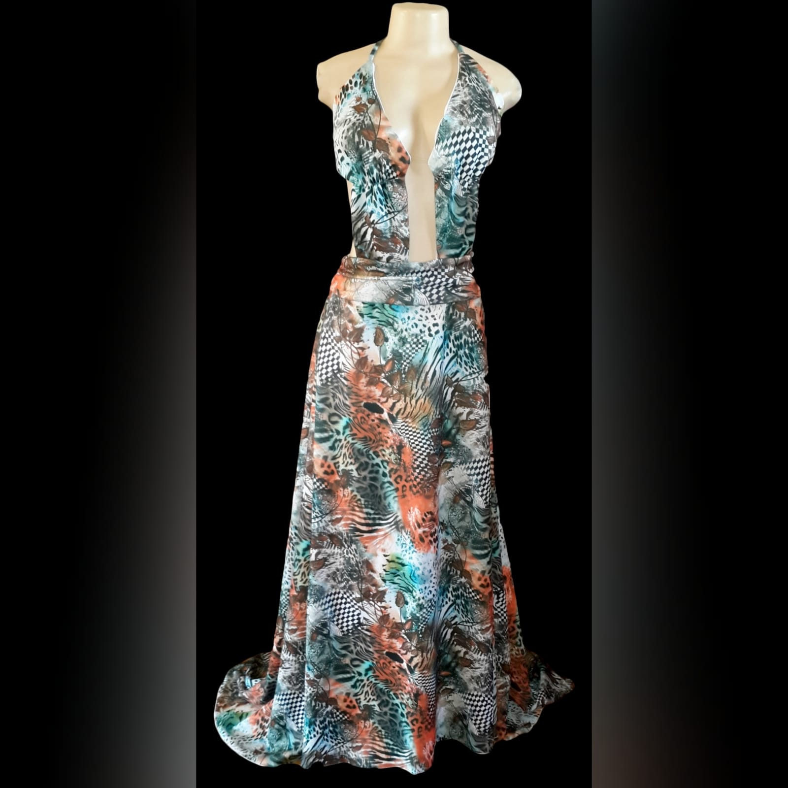 Printed long plunging neckline matric dance dress 8 printed long plunging neckline matric dance dress with a naked back and a train