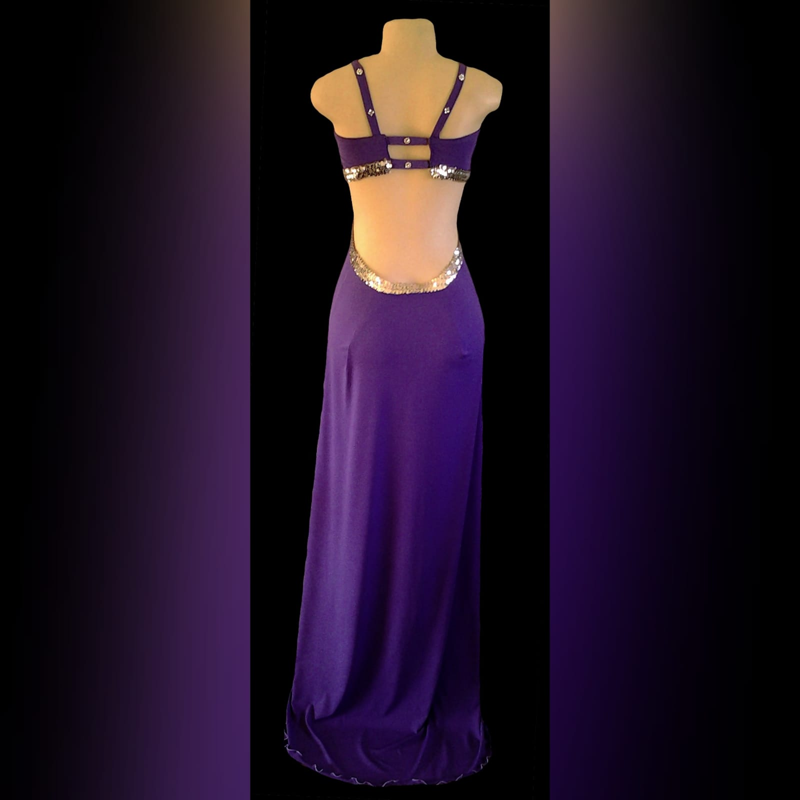 Purple long sexy prom dress 6 purple long sexy prom dress, with side tummy openings, cleavage opening, open low back and a slit, all detailed with silver sequins.