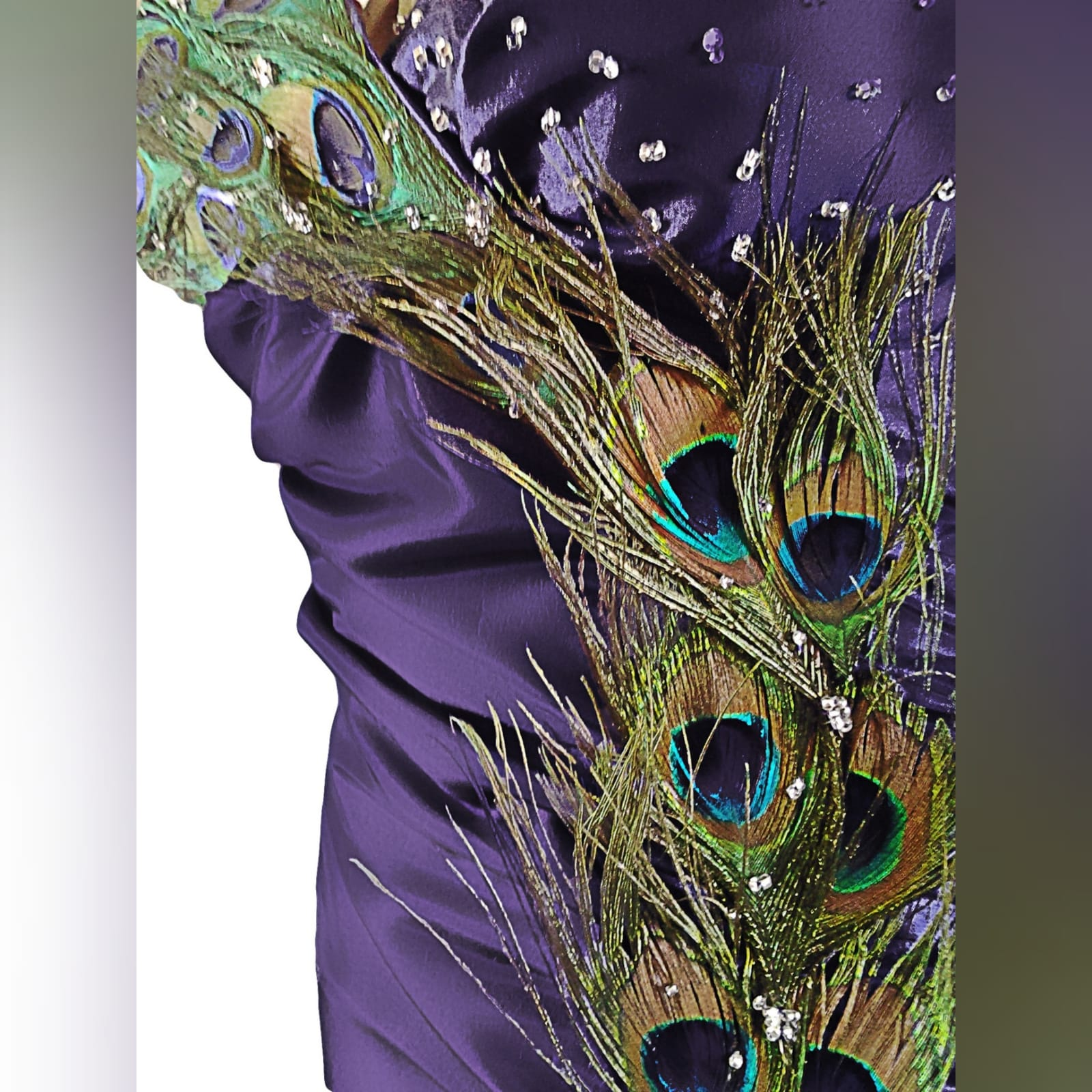 Purple peacock prom dance dress 5 purple prom dance dress detailed with peacock feathers and silver beads, with a slit, halter neck and matching hair accessory.