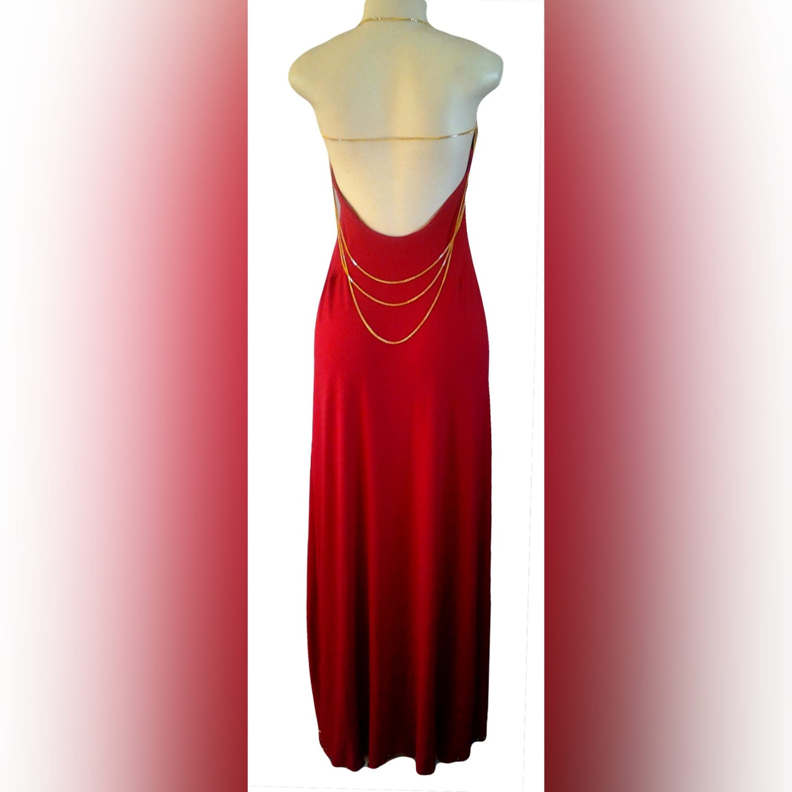 Red and gold long sexy gala dress 3 red and gold long sexy gala dress with an open back detailed with gold chain. With a slit detailed with gold beads.