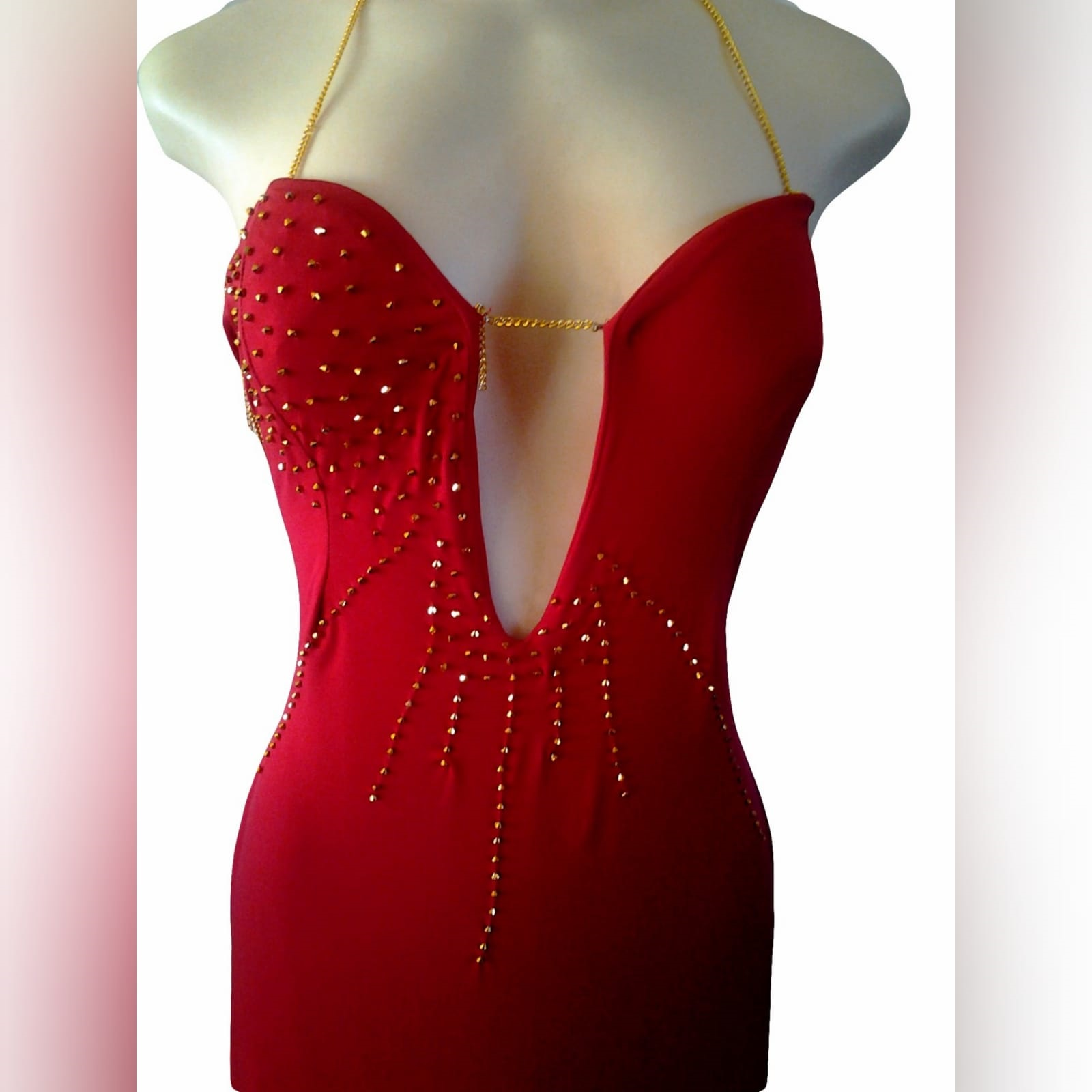 Red and gold long sexy gala dress 4 red and gold long sexy gala dress with an open back detailed with gold chain. With a slit detailed with gold beads.
