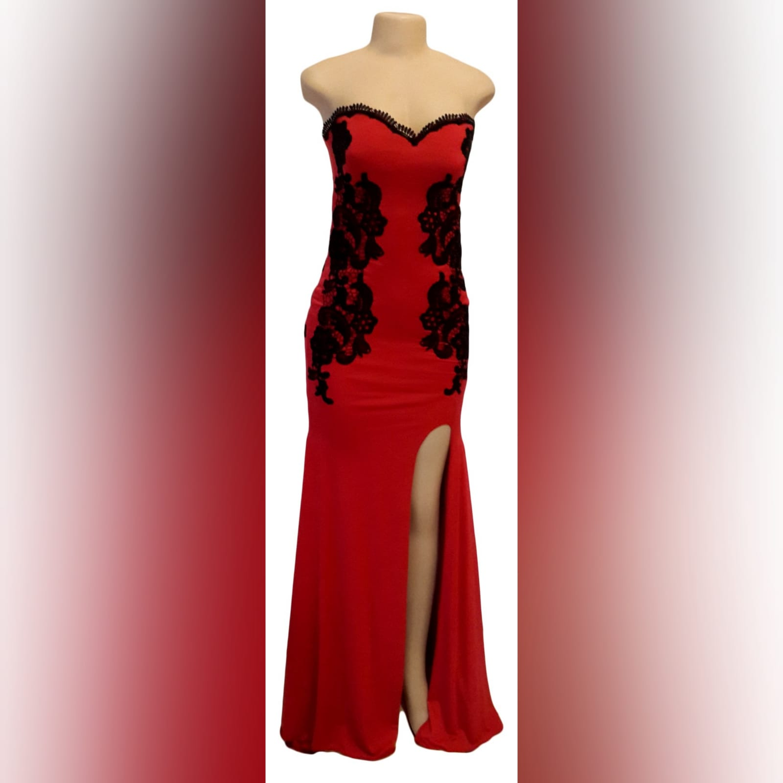 Red evening dress detailed with black lace 5 red evening dress detailed with black lace on the sides, front & back. With a sweetheart neckline finished with black scallop lace.
