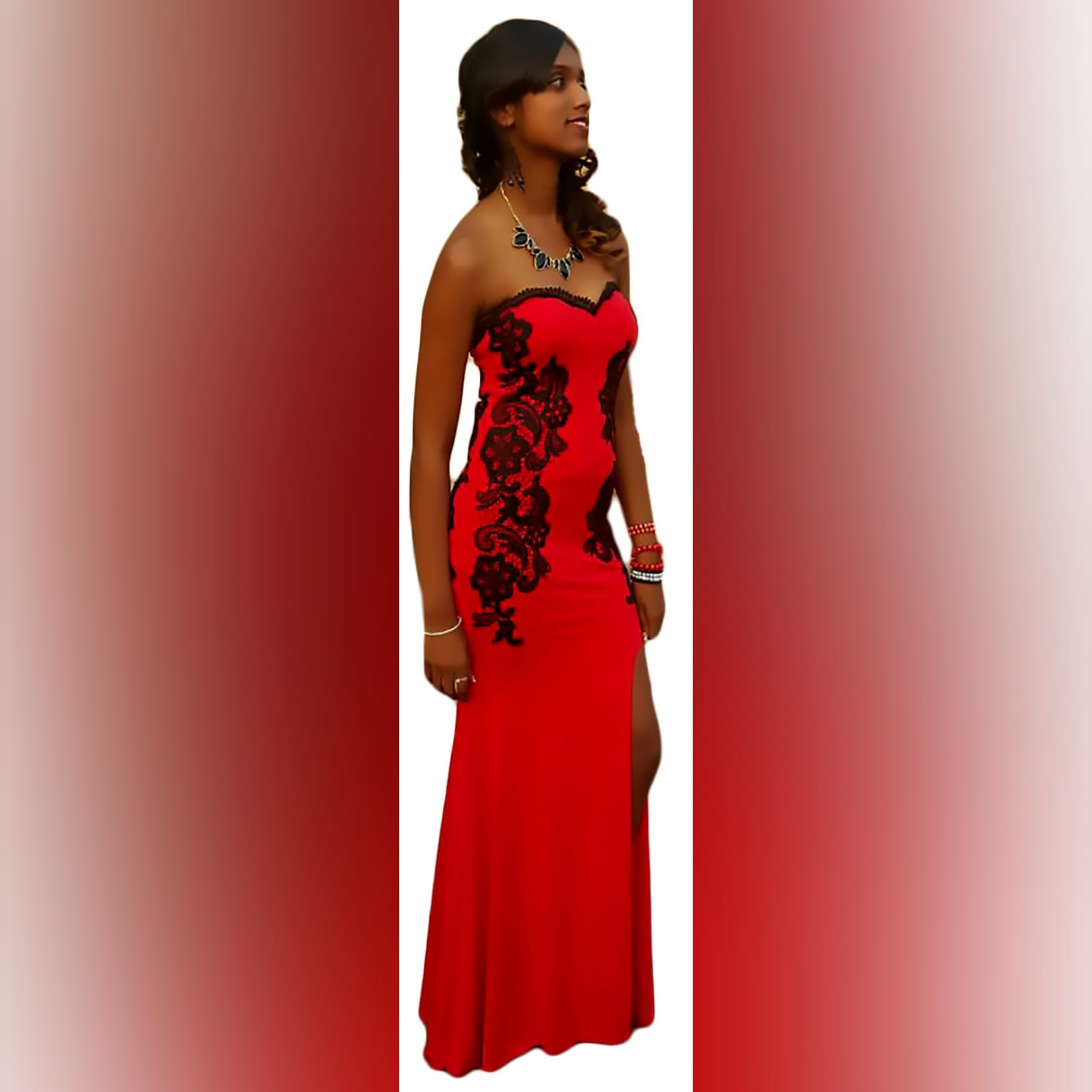 Red evening dress detailed with black lace 1 red evening dress detailed with black lace on the sides, front & back. With a sweetheart neckline finished with black scallop lace.