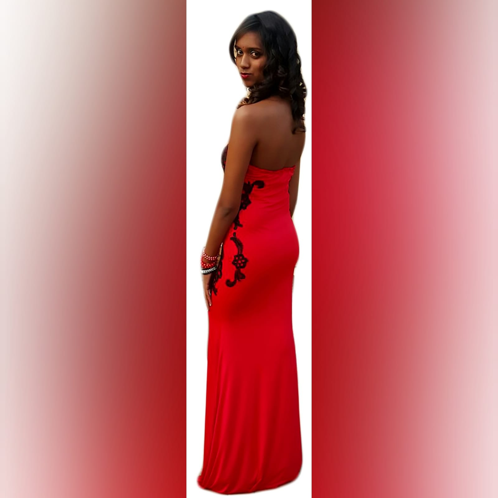 Red evening dress detailed with black lace 2 red evening dress detailed with black lace on the sides, front & back. With a sweetheart neckline finished with black scallop lace.