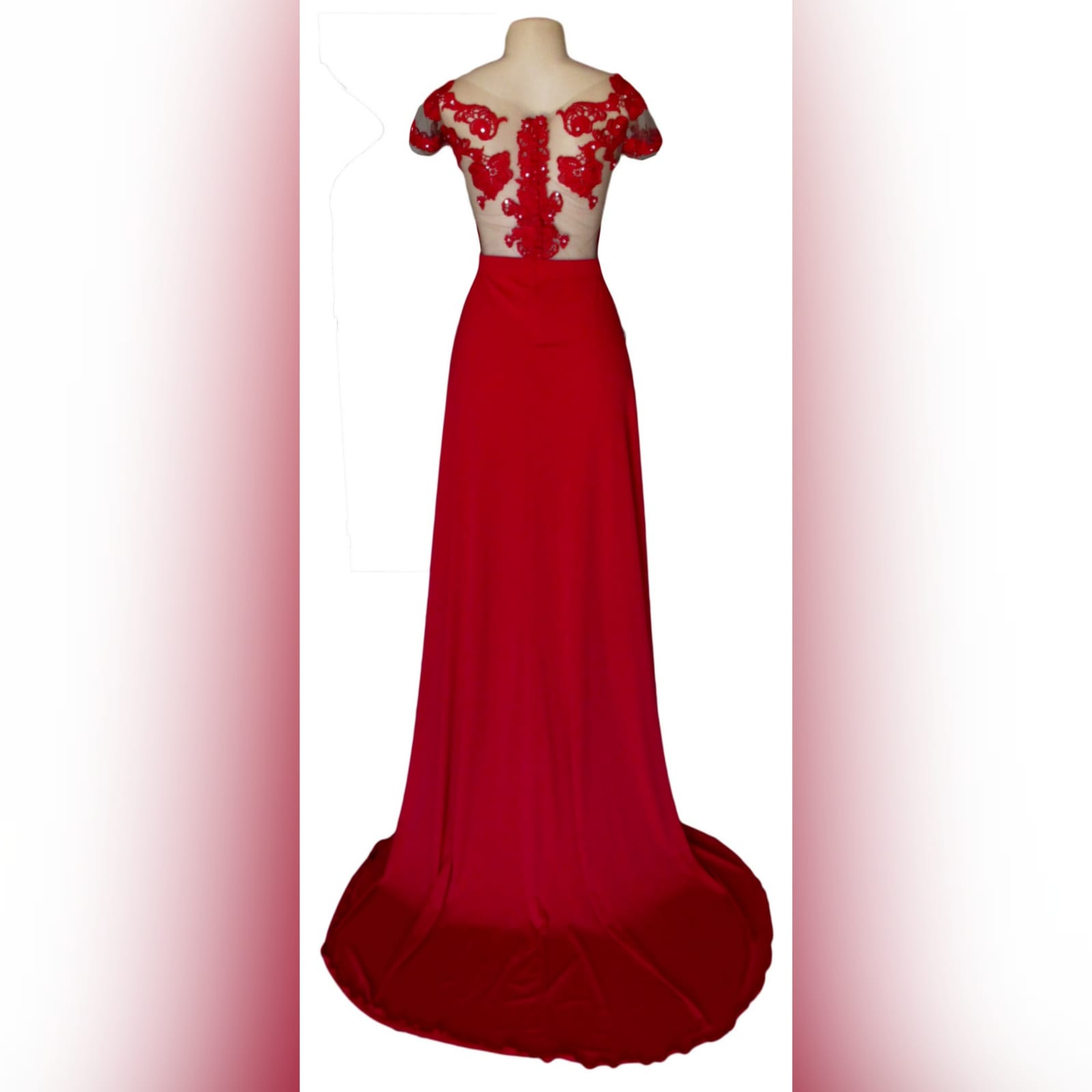 Red flowy lace bodice prom dress 4 red flowy lace bodice prom dress. With an illusion lace bodice detailed with silver beads and buttons. Evening dress with a slit and a train.
