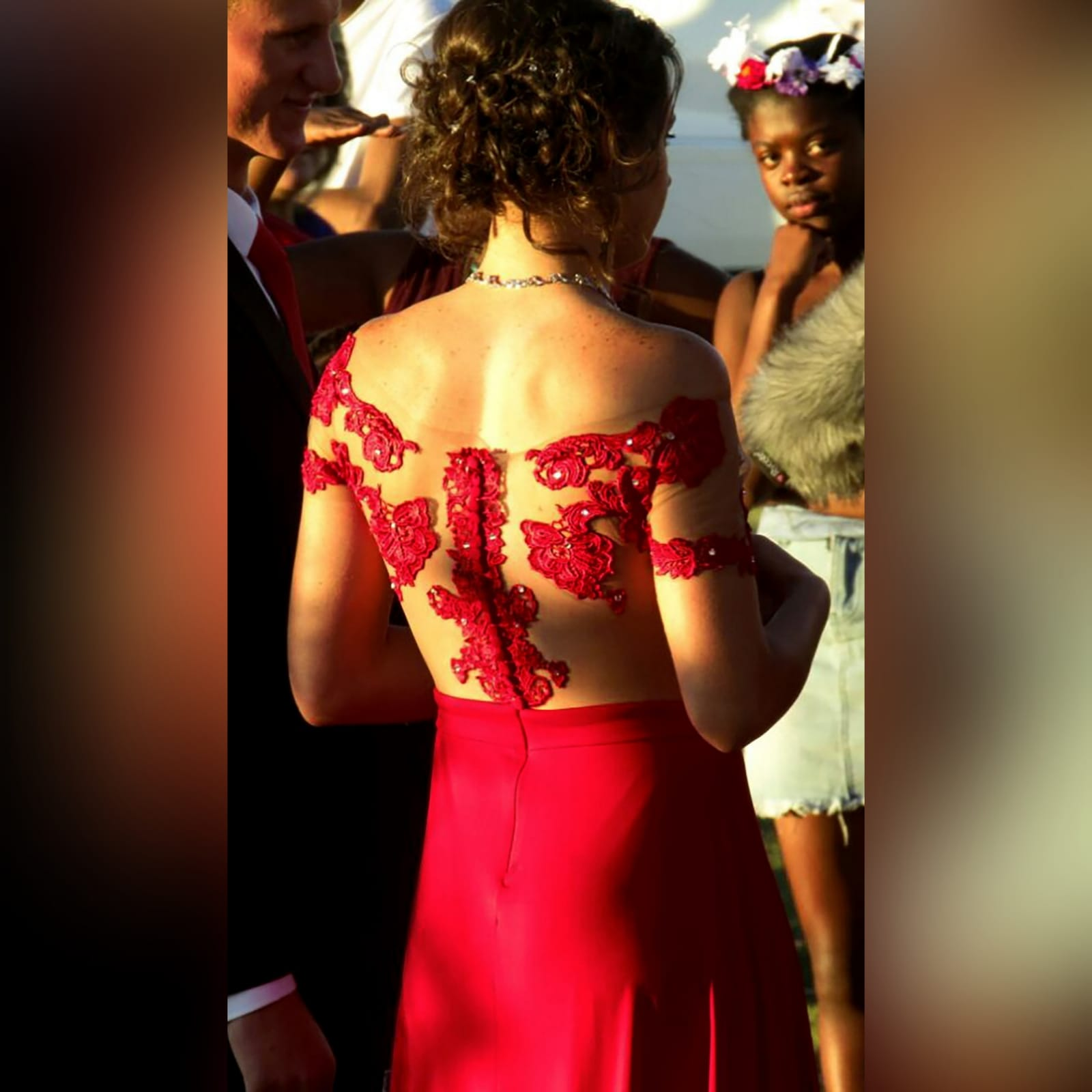 Red flowy lace bodice prom dress 6 red flowy lace bodice prom dress. With an illusion lace bodice detailed with silver beads and buttons. Evening dress with a slit and a train.