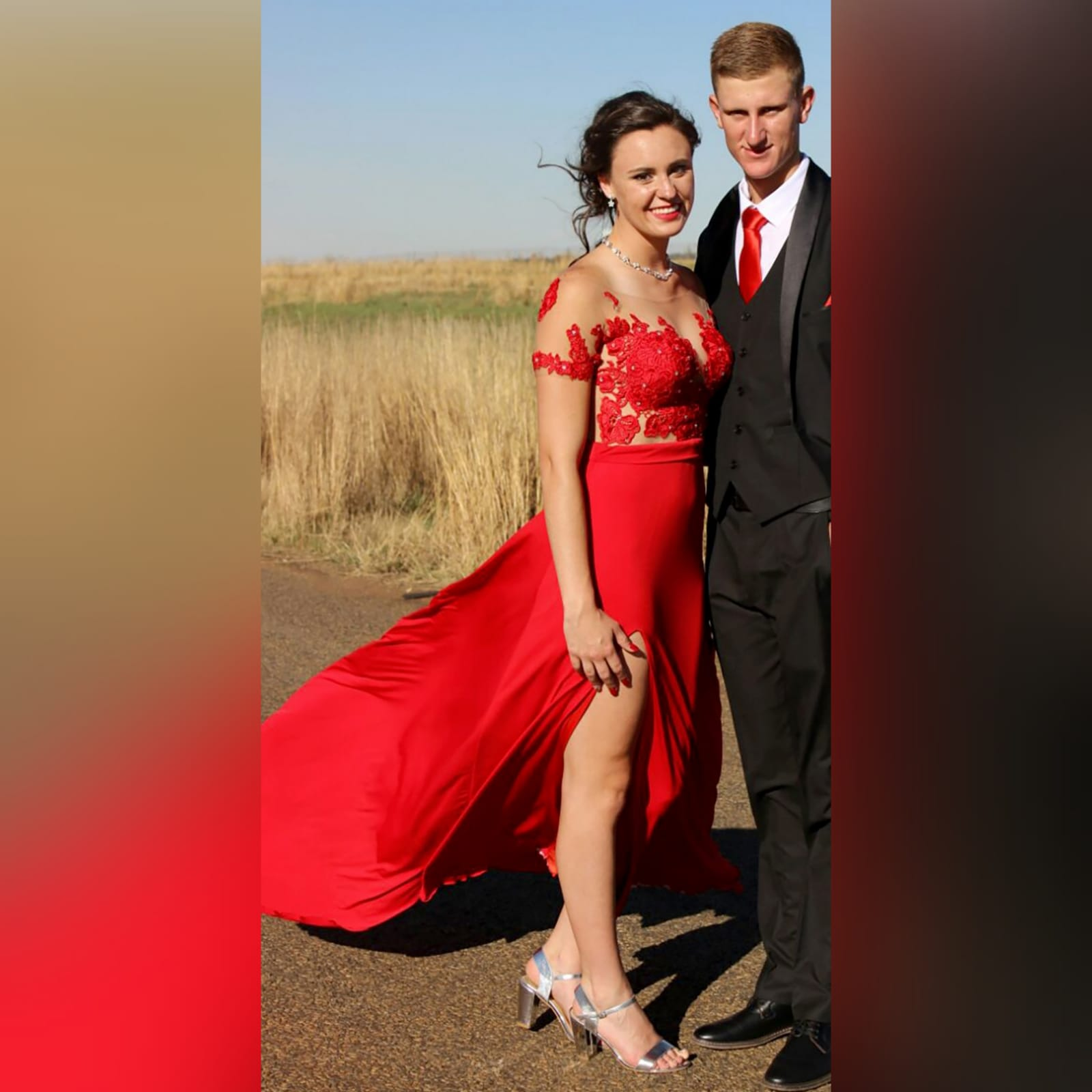 Red flowy lace bodice prom dress 7 red flowy lace bodice prom dress. With an illusion lace bodice detailed with silver beads and buttons. Evening dress with a slit and a train.