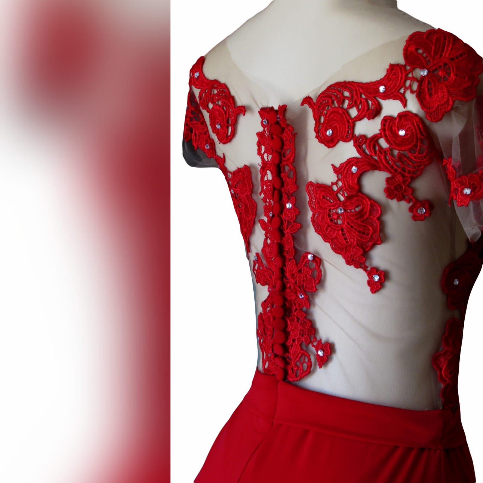 Red flowy lace bodice prom dress 8 red flowy lace bodice prom dress. With an illusion lace bodice detailed with silver beads and buttons. Evening dress with a slit and a train.