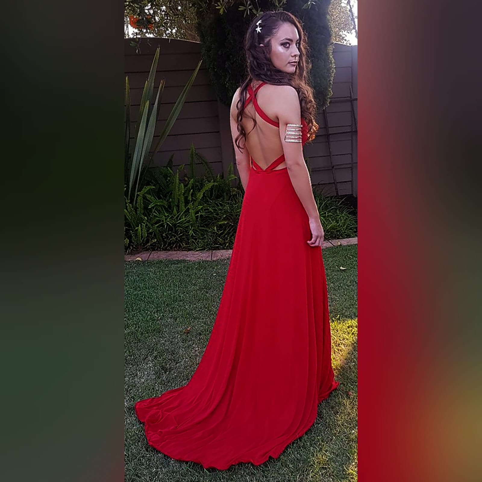 Red long sexy long prom dress 2 red long sexy long prom dress with a low v neckline & slit, a low open back with cross straps on the upper back, with a train.