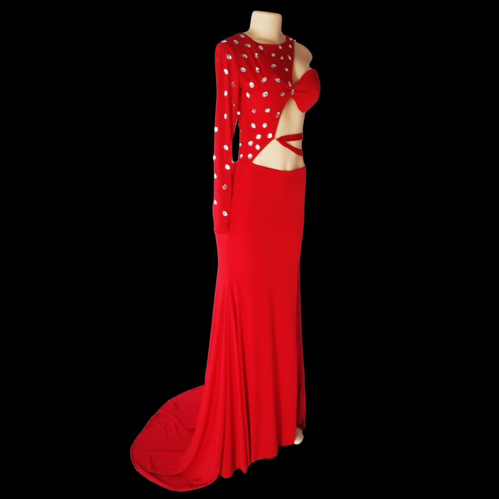 Red sexy different sweet 16 birthday party evening dress 4 red sexy and different sweet 16 evening dress. With a slit and a train and a closed and open side. Single sleeve, the dress is tied from the centre of the back to the centre of the front. Closed side and sleeve with clear silver beads