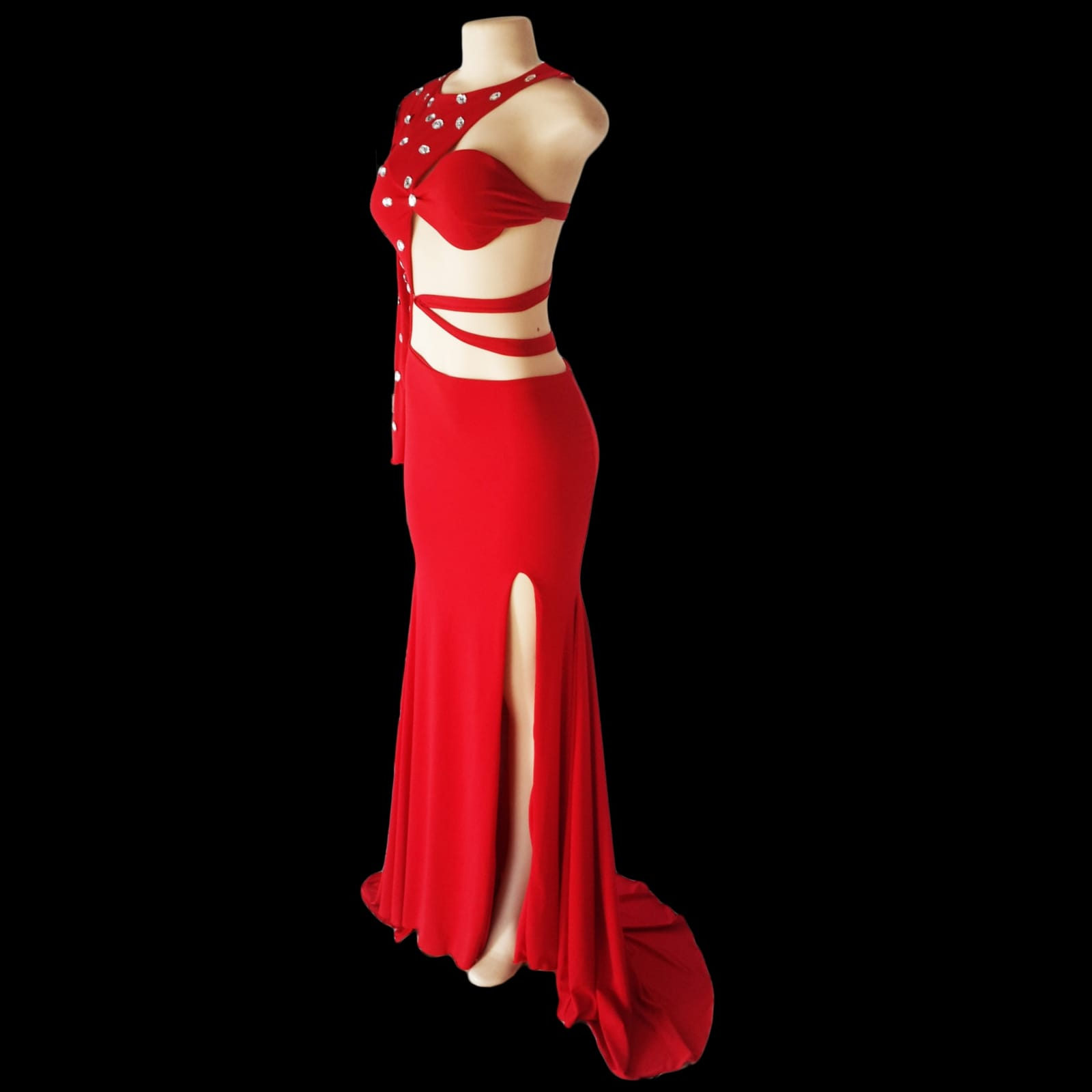 Red sexy different sweet 16 birthday party evening dress 6 red sexy and different sweet 16 evening dress. With a slit and a train and a closed and open side. Single sleeve, the dress is tied from the centre of the back to the centre of the front. Closed side and sleeve with clear silver beads