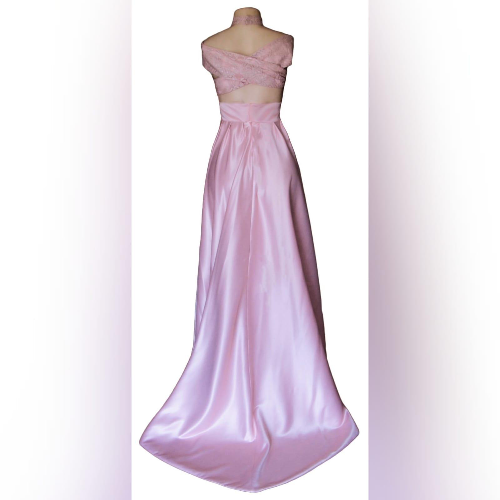 Rose pink plunging neckline off shoulder prom dress 3 rose pink plunging neckline off shoulder prom dress, flowy with a slit and a train. Crossed back design