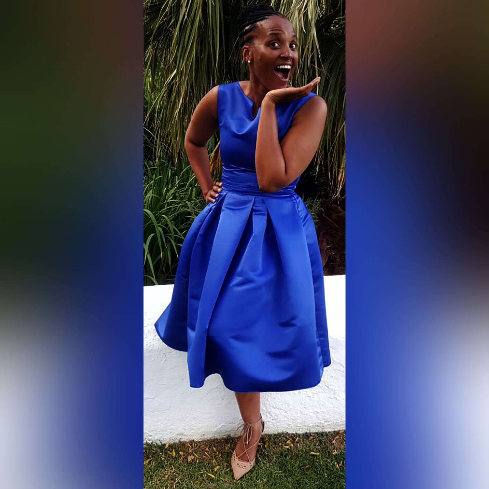 Royal blue 3/4 length pleated evening dress 1 royal blue 3/4 length pleated evening dress with a fitted bodice with a slit rounded neckline.