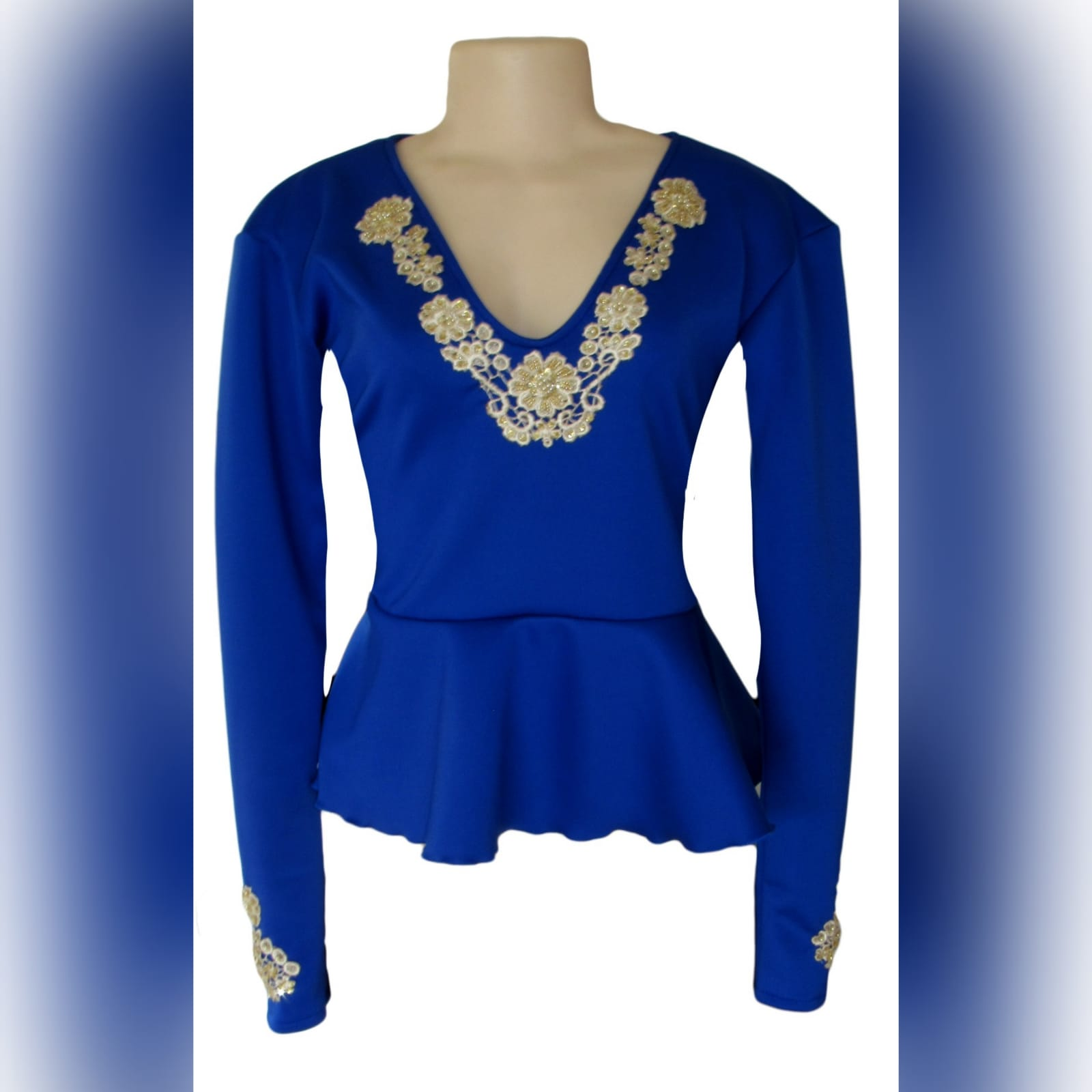 Royal blue & gold peplum smart casual top 1 royal blue & gold peplum smart casual top, long sleeves, v neckline & cuffs detailed with gold beaded lace