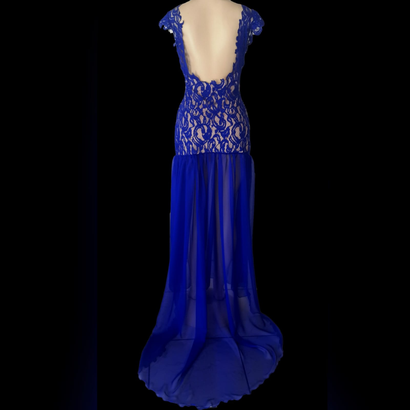 Royal blue pageant evening dress 2 royal blue pageant evening dress, with a lace bodice lined in nude, with a sheer gathered chiffon bottom with high slit, and a rounded open back.