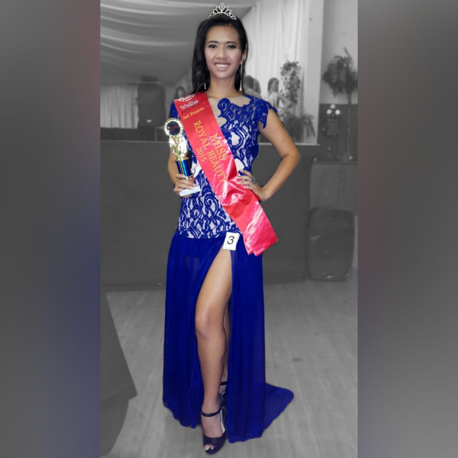 Royal blue pageant evening dress 1 royal blue pageant evening dress, with a lace bodice lined in nude, with a sheer gathered chiffon bottom with high slit, and a rounded open back.