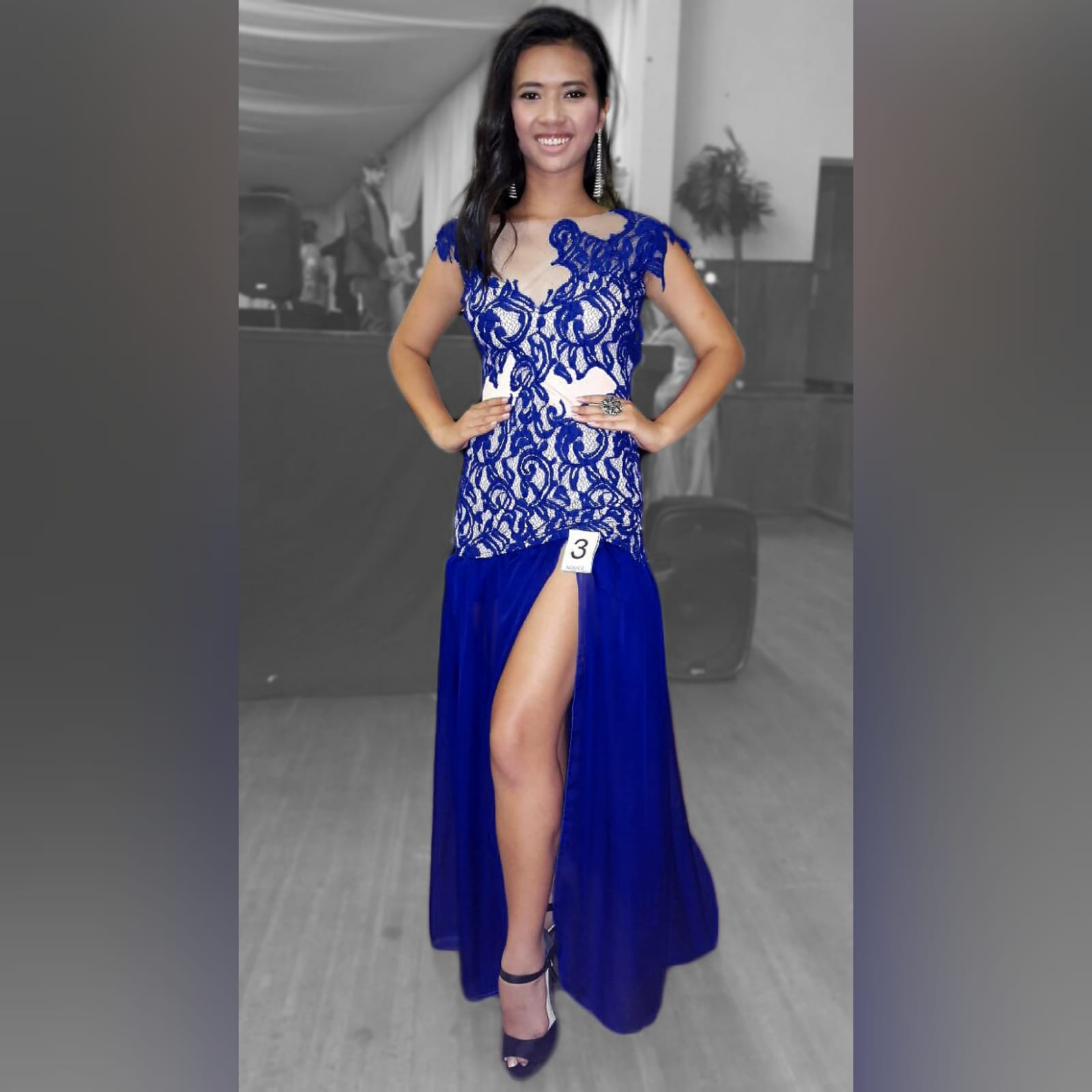 Royal blue pageant evening dress 4 royal blue pageant evening dress, with a lace bodice lined in nude, with a sheer gathered chiffon bottom with high slit, and a rounded open back.