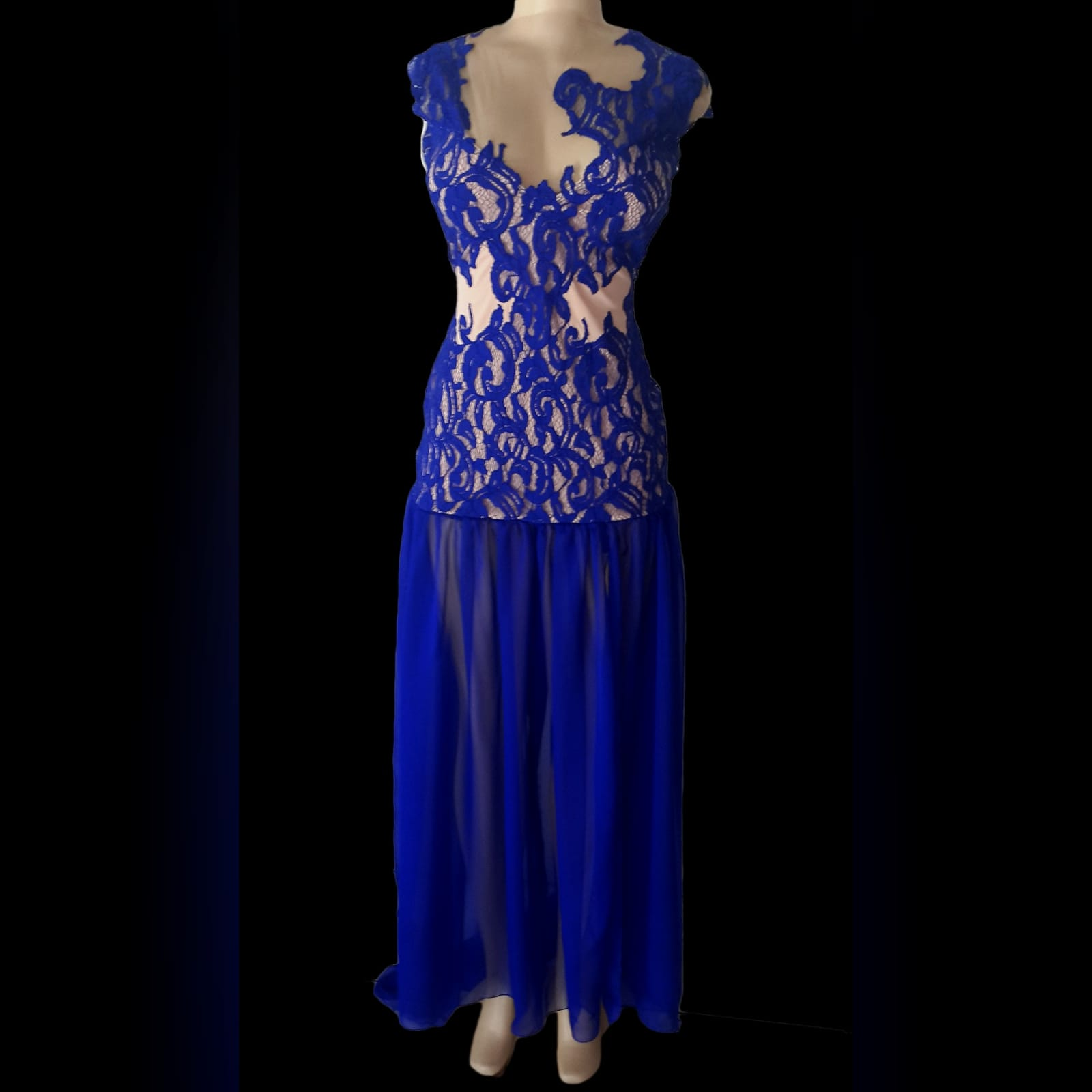 Royal blue pageant evening dress 5 royal blue pageant evening dress, with a lace bodice lined in nude, with a sheer gathered chiffon bottom with high slit, and a rounded open back.