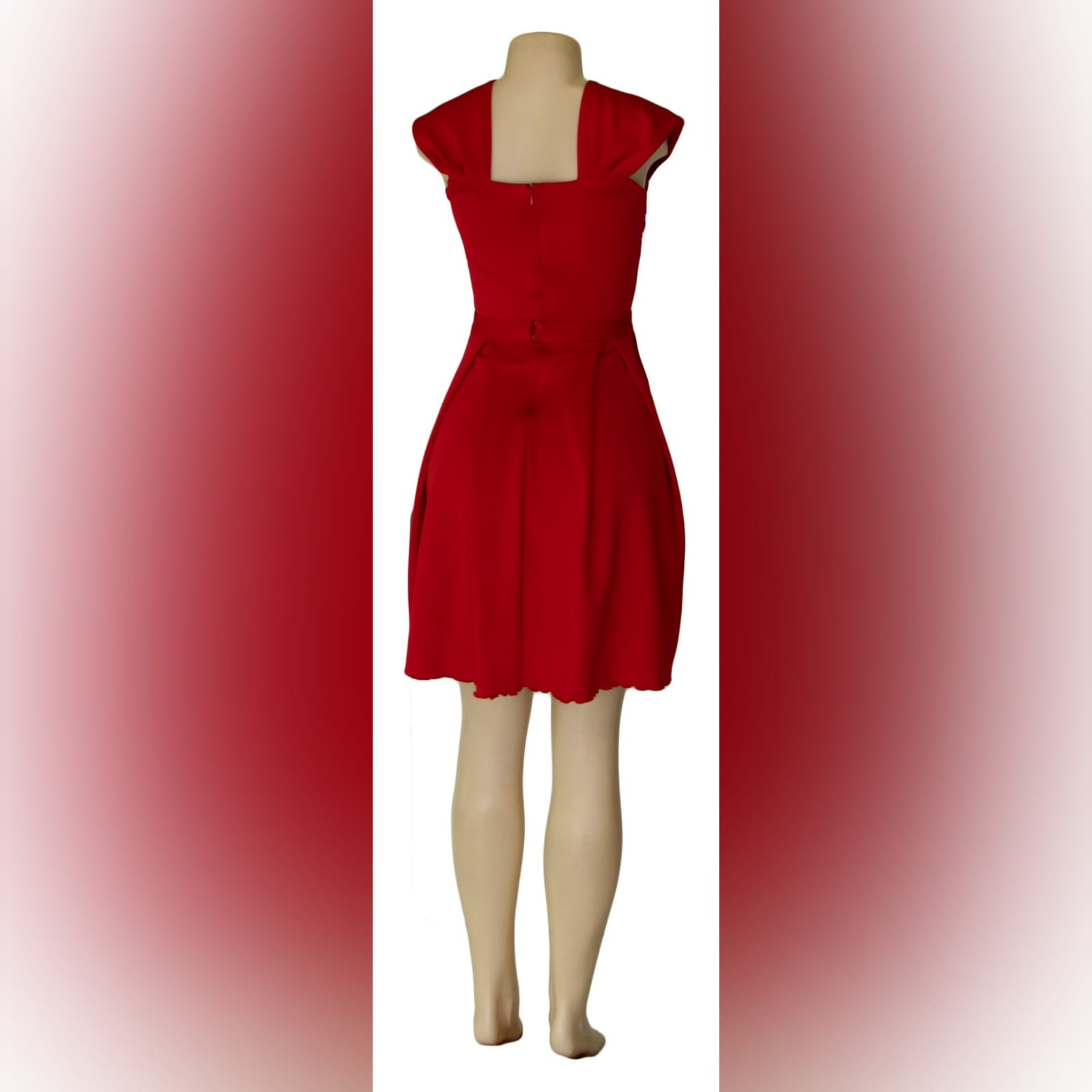 Short red pleated evening dress 3 short red pleated evening dress with a pleated sweetheart neckline and a detachable belt with bow detail