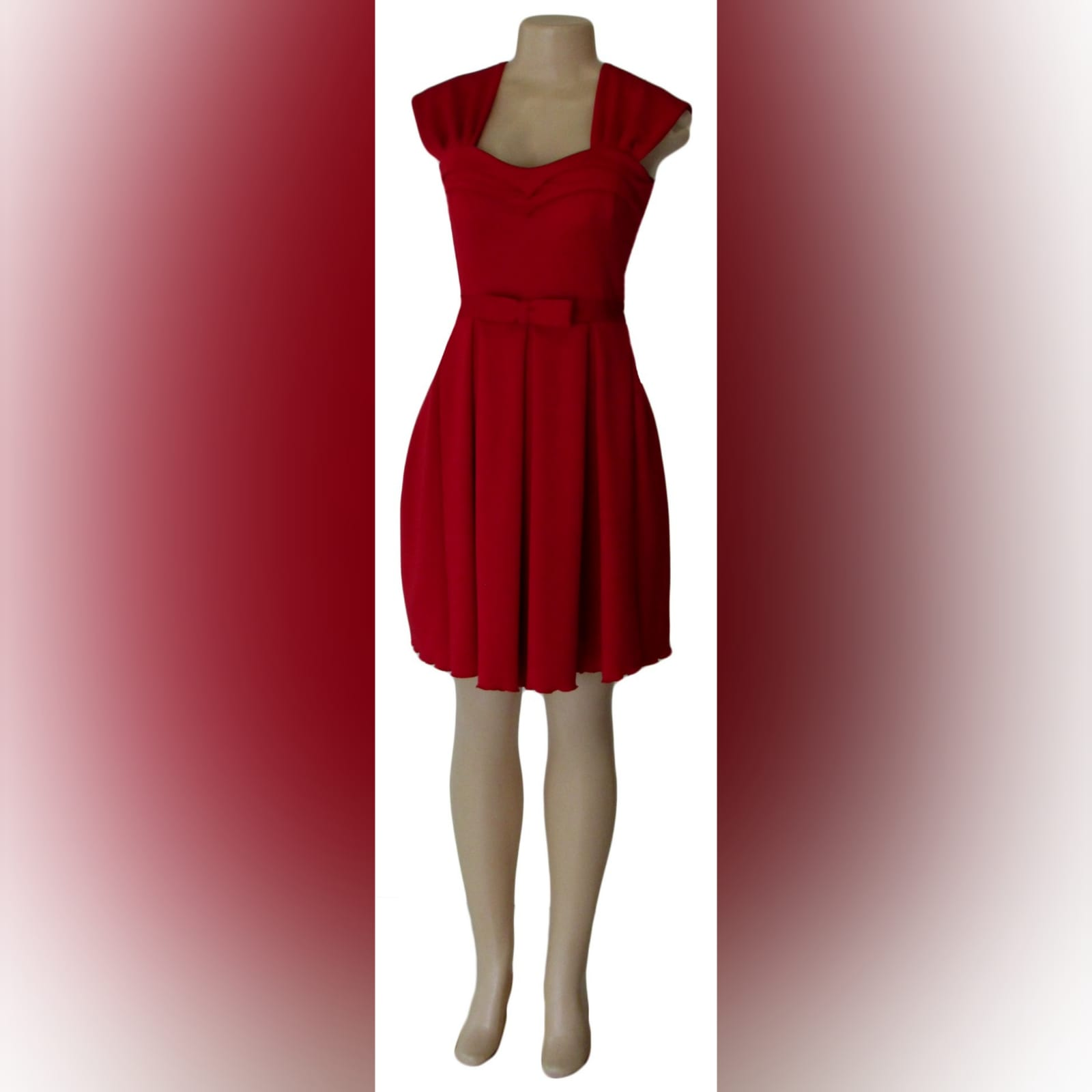 Short red pleated evening dress 1 short red pleated evening dress with a pleated sweetheart neckline and a detachable belt with bow detail