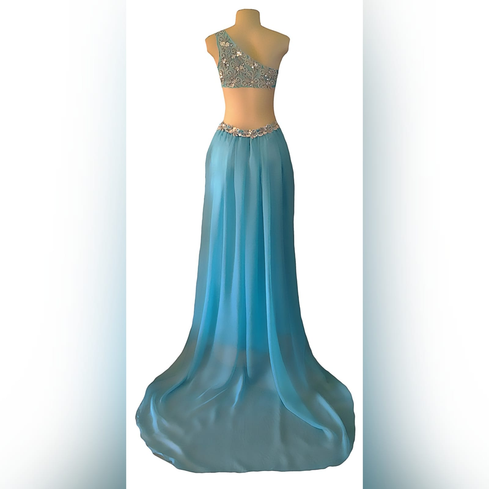 Sky blue chiffon long matric farewell dress 8 sky blue chiffon long matric farewell dress with side tummy opening and low open back. Detailed with silver embellishments. With gathered back chiffon train.