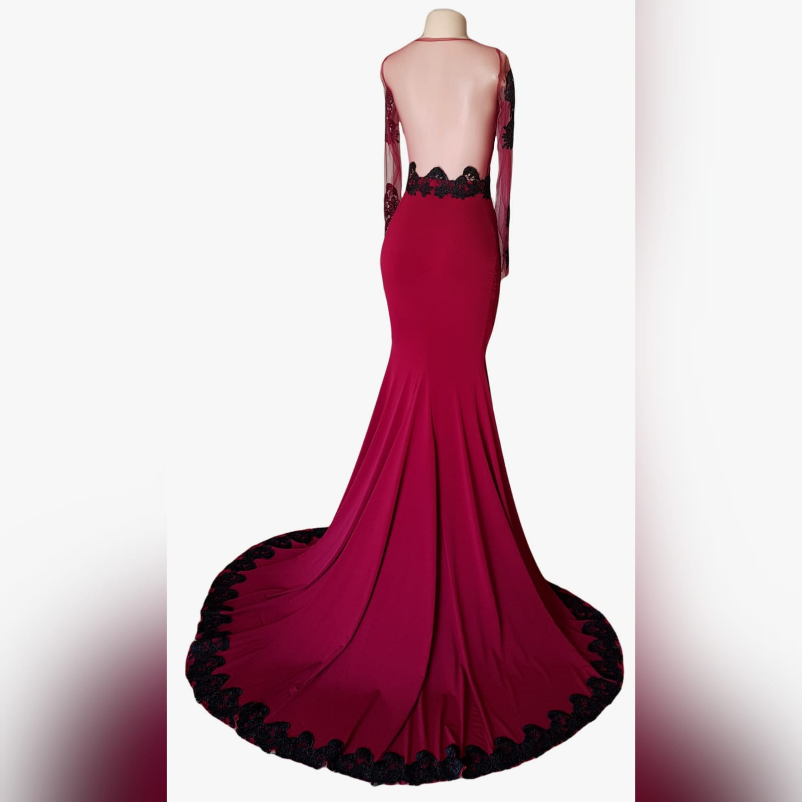 Soft mermaid burgundy matric farewell dress detailed with black lace 2 palesa looked gorgeous with my creation. A soft mermaid burgundy matric farewell dress detailed with black lace. With a sheer open back and long sheer sleeves detailed with black lace.