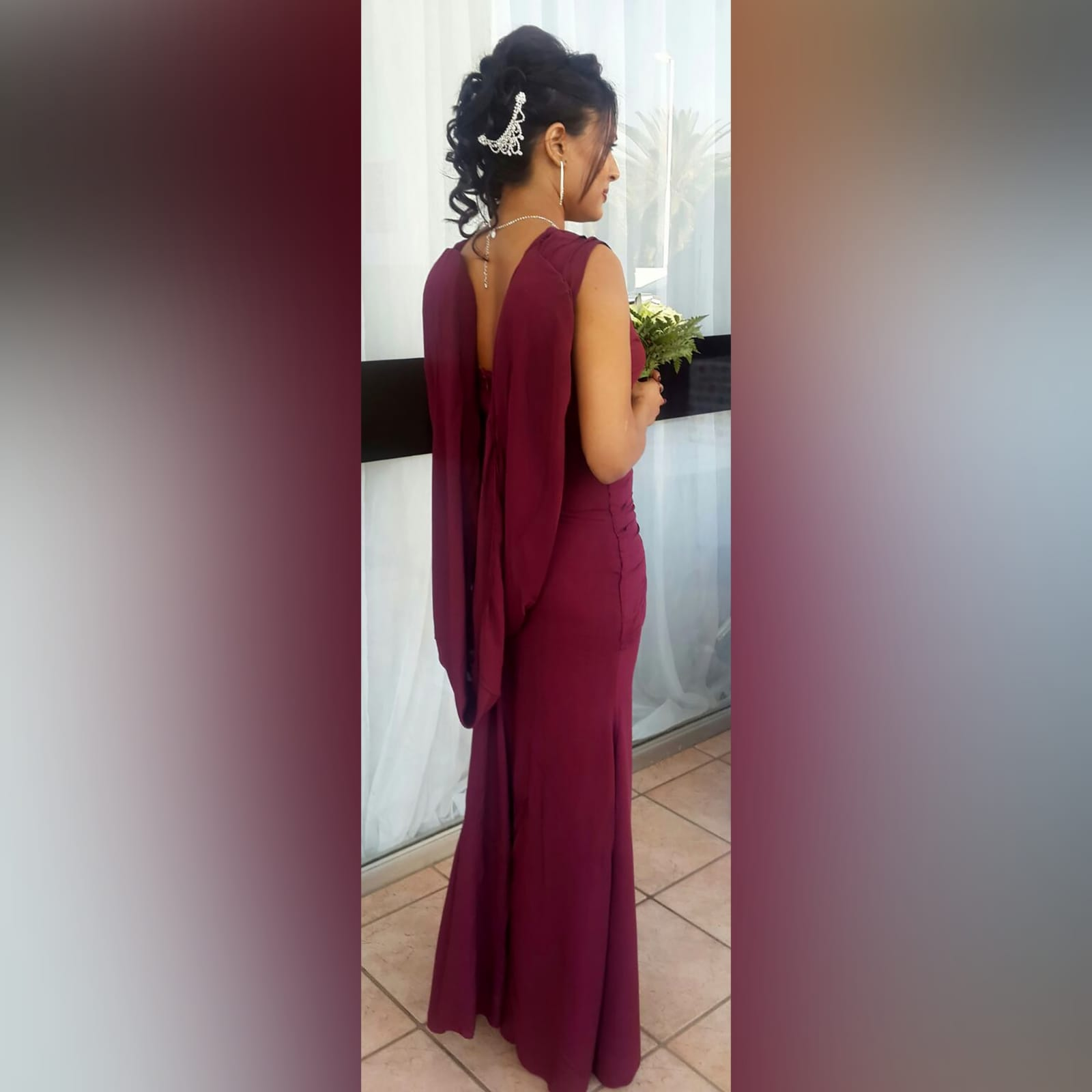 Soft mermaid maroon maid of honour dress 3 soft mermaid, maroon, maid of honour dress. With an open back. V neckline. With gathered shoulder and pleated tummy panel effect. With a detachable shoulder piece. Added silver detailing.