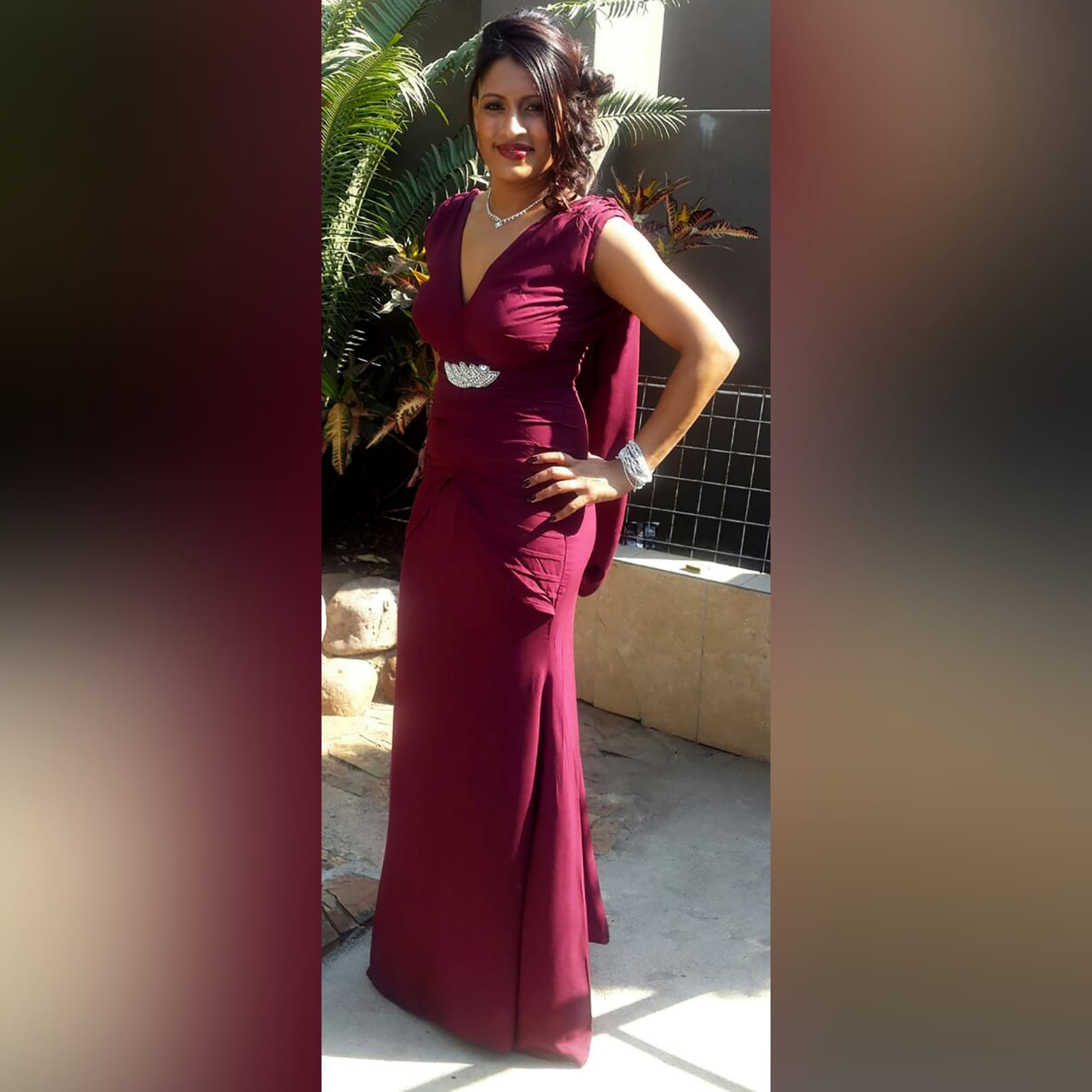 Soft mermaid maroon maid of honour dress 1 soft mermaid, maroon, maid of honour dress. With an open back. V neckline. With gathered shoulder and pleated tummy panel effect. With a detachable shoulder piece. Added silver detailing.