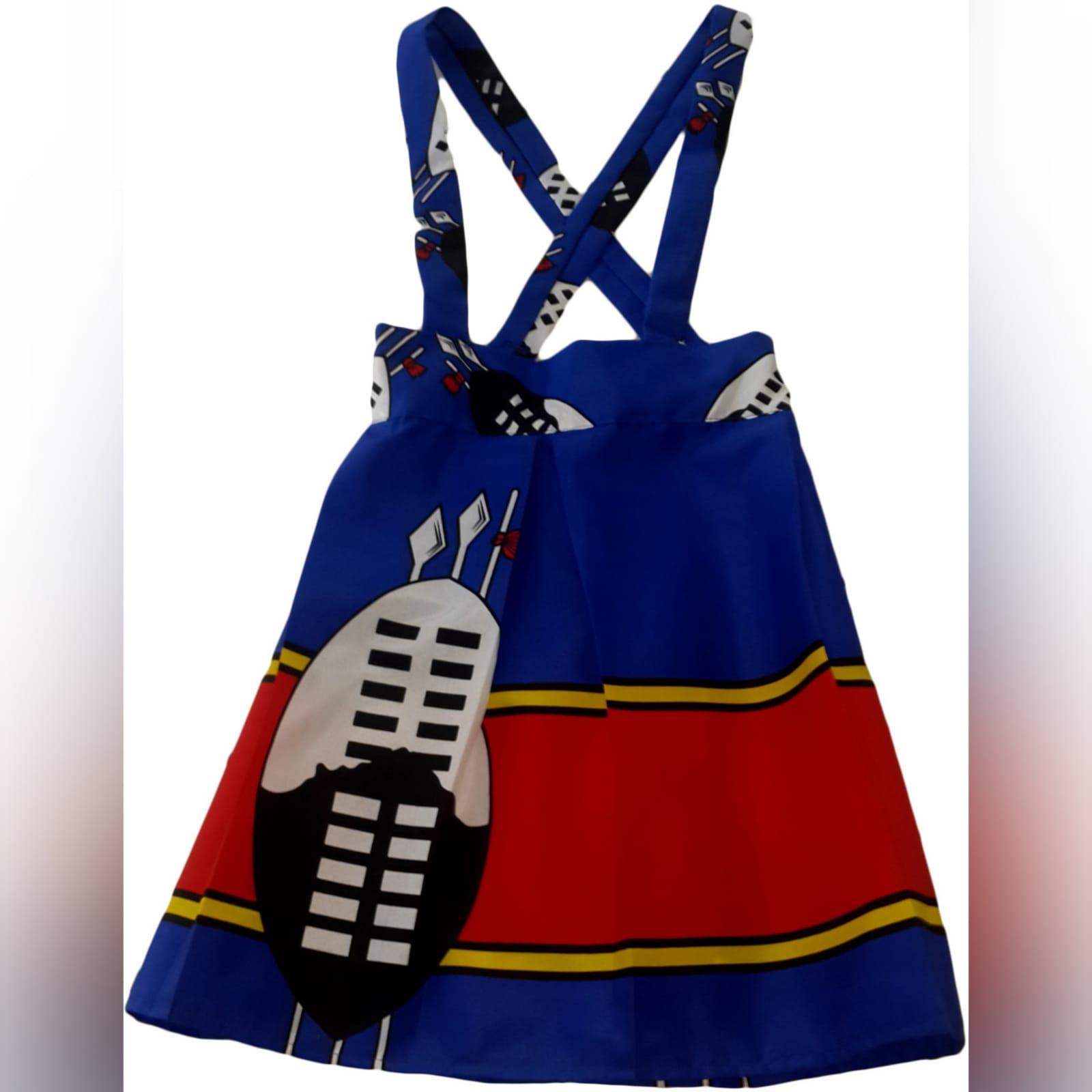Swati traditional wedding attire 5 mens swazi/swati short sleeve shirt. High waisted swazi/swati skirt. High waisted pleated swazi/swati skirt with crossed shoulder straps. One sleeve little girls swazi/swati dress with shoulder strap. Traditional wedding attire