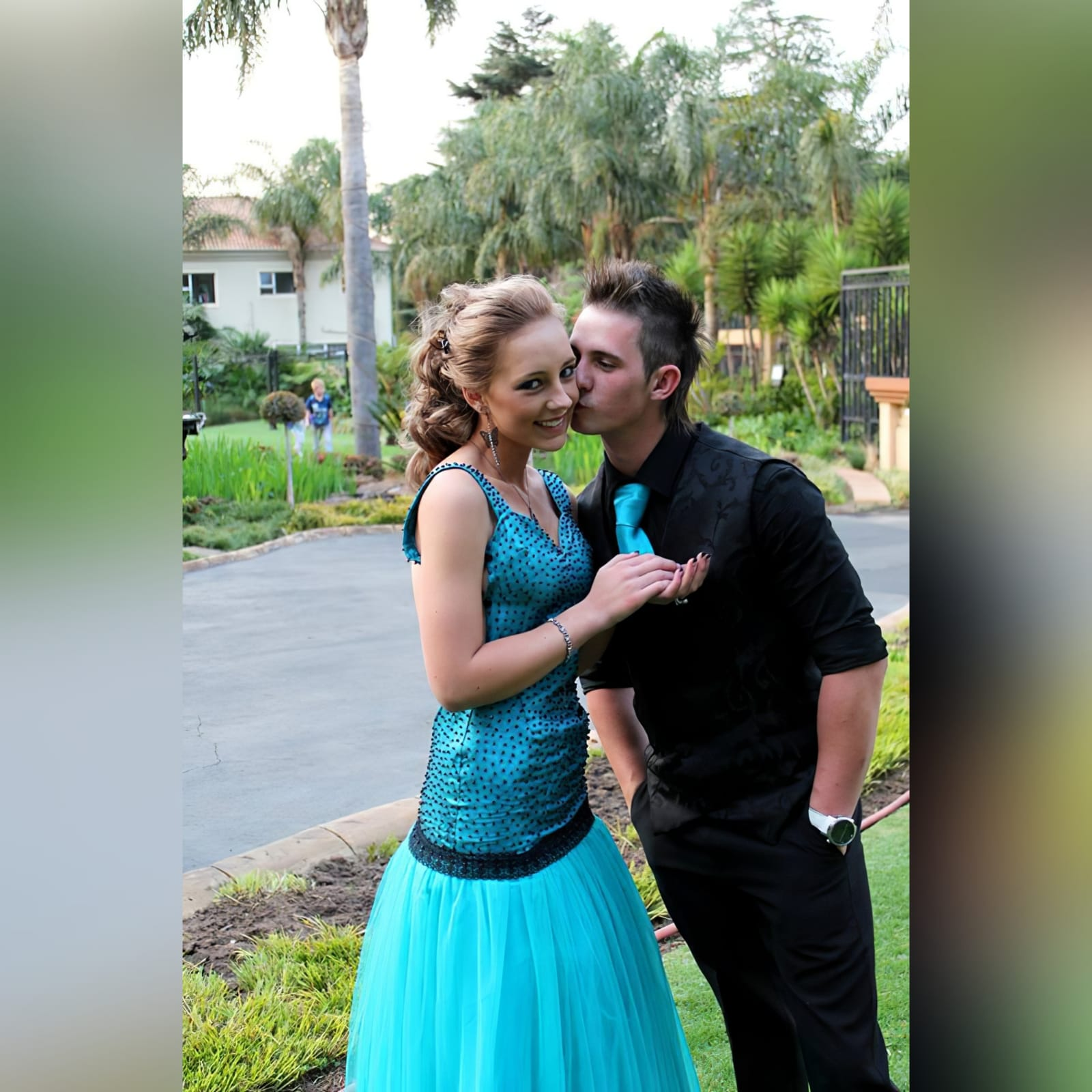 Turquoise blue and black matric farewell dress 1 turquoise blue and black matric farewell dress with a scattered beaded bodice with a low open back and a tulle bottom.