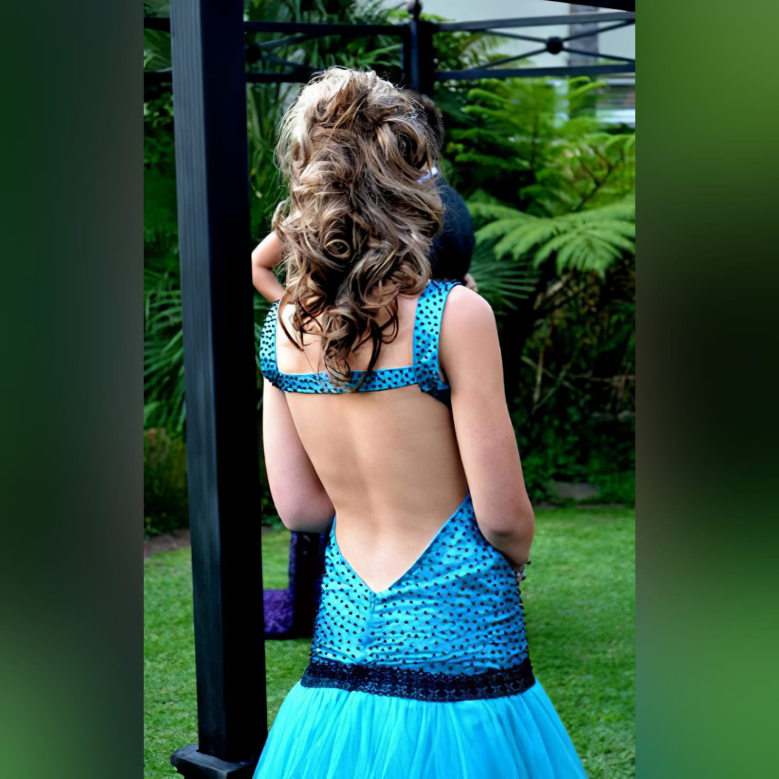 Turquoise blue and black matric farewell dress 3 turquoise blue and black matric farewell dress with a scattered beaded bodice with a low open back and a tulle bottom.