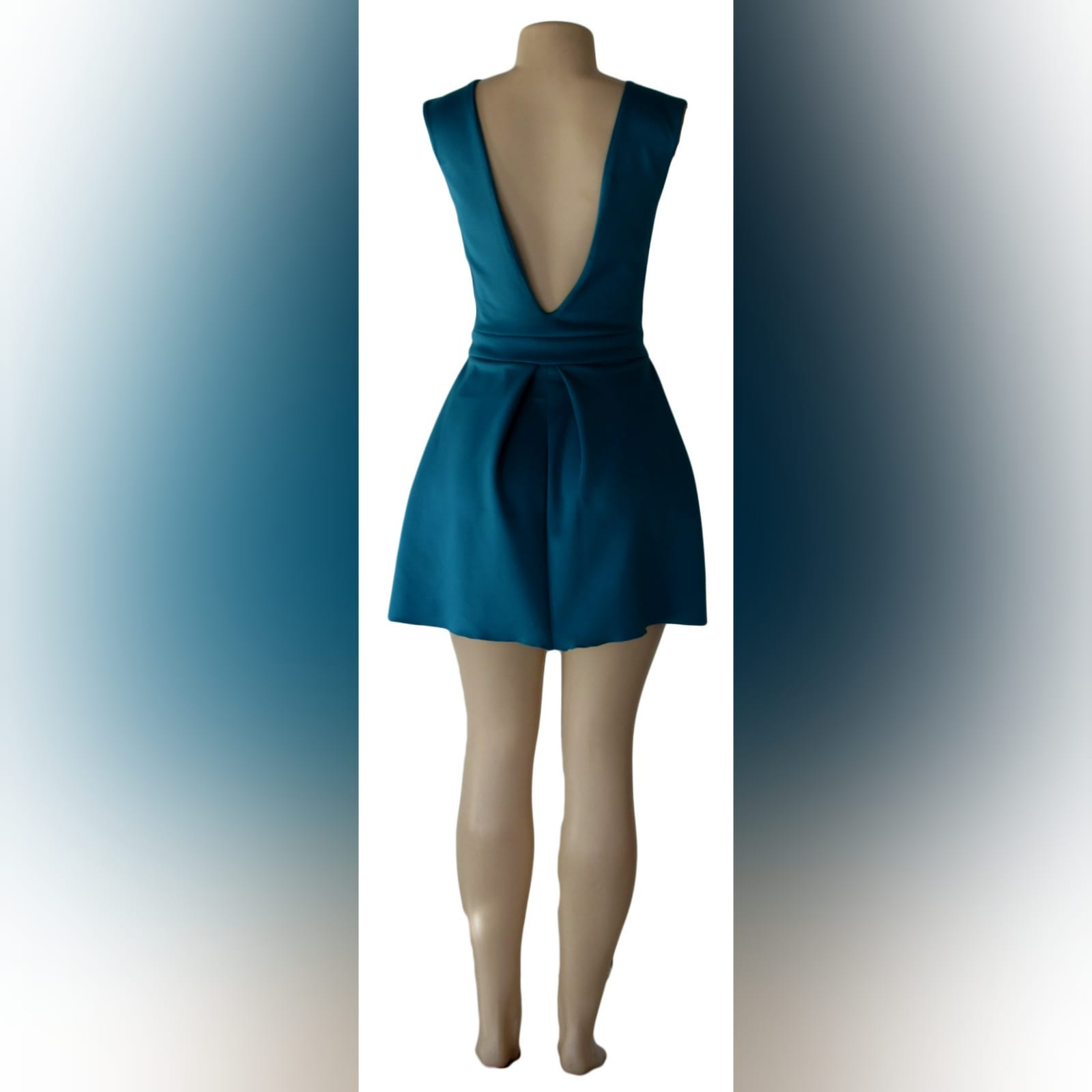 Turquoise green short smart casual dress 2 turquoise green short smart casual dress with a v neckline in front and a low v open back, with a waistband, and wide pleats on the bottom.