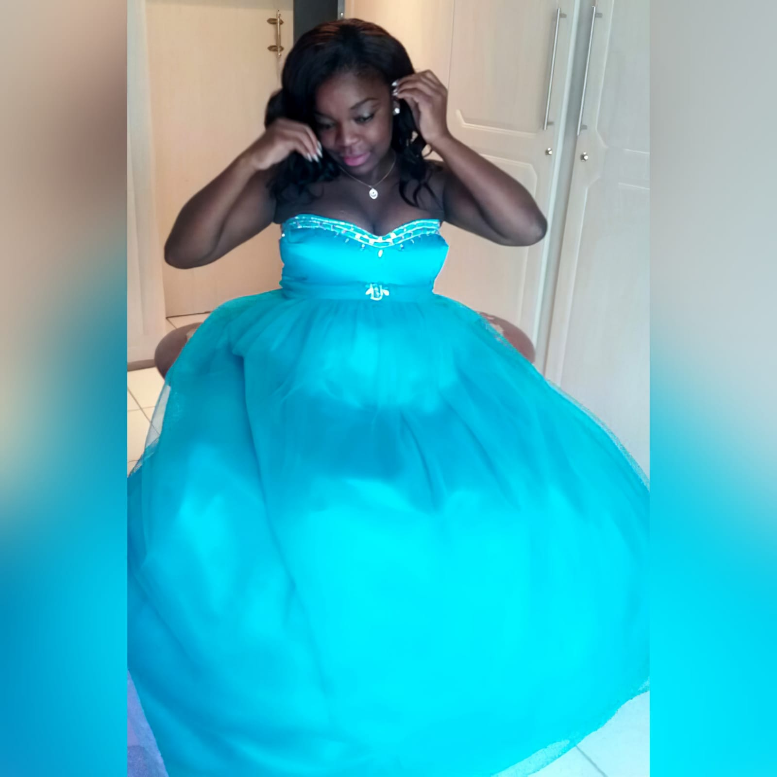 Turquoise and silver ball gown custom made wedding dress 3 turquoise & silver ball gown custom-made wedding dress. With a sweetheart neckline. A lace-up back with an optional back cover panel. Detailed with silver diamante and beads. Ruched belt effect.