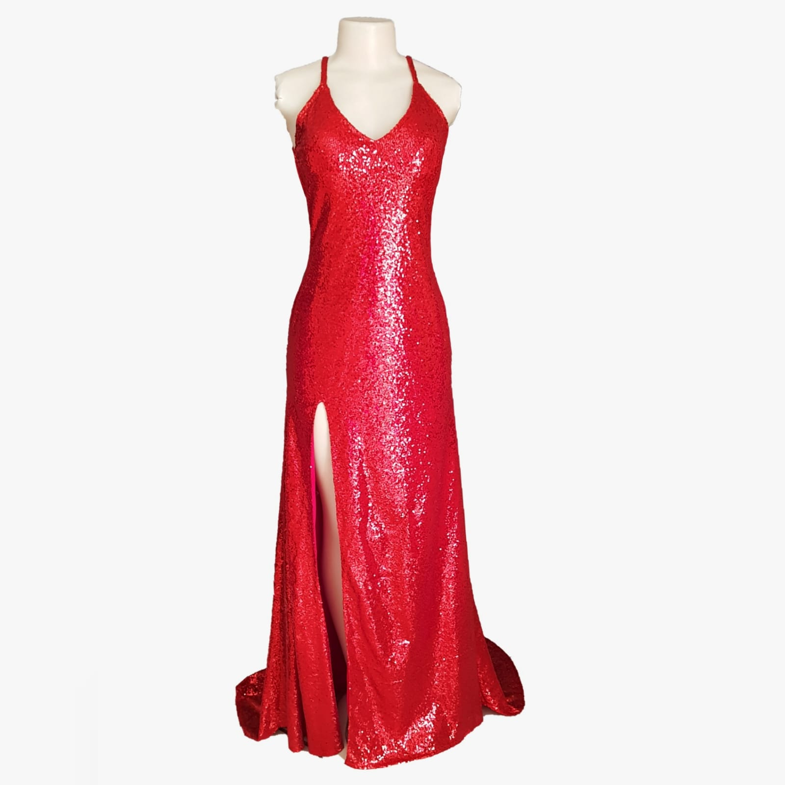 A long red sexy sequins evening dress 6 why not wear red to your next event? A long red sexy sequins evening dress that shows off your confidence. A passionate colour, which will make you feel adventurous. A low naked back with a high slit for a touch of seduction. Wear this design and colour and you will make a statement.