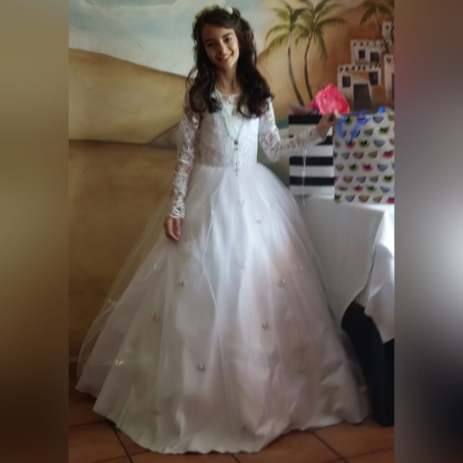 White holy communion ball gown dress 7 white holy communion ball gown dress. With a lace bodice. Long lace sleeves. Holy communion dress detailed with butterflies.