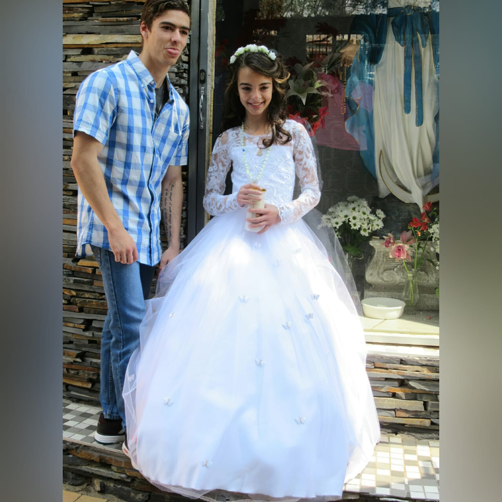 White holy communion ball gown dress 3 white holy communion ball gown dress. With a lace bodice. Long lace sleeves. Holy communion dress detailed with butterflies.