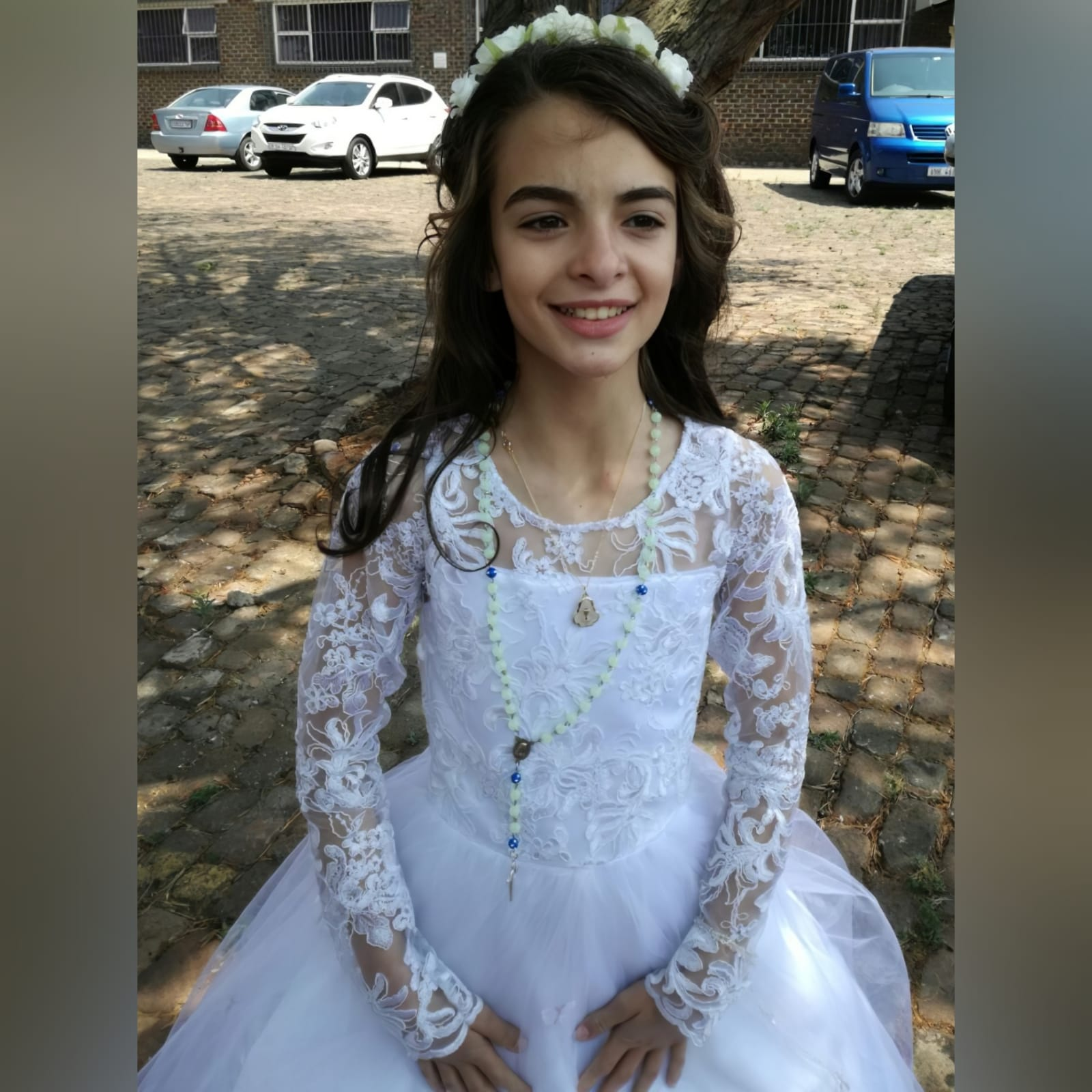 White holy communion ball gown dress 1 white holy communion ball gown dress. With a lace bodice. Long lace sleeves. Holy communion dress detailed with butterflies.