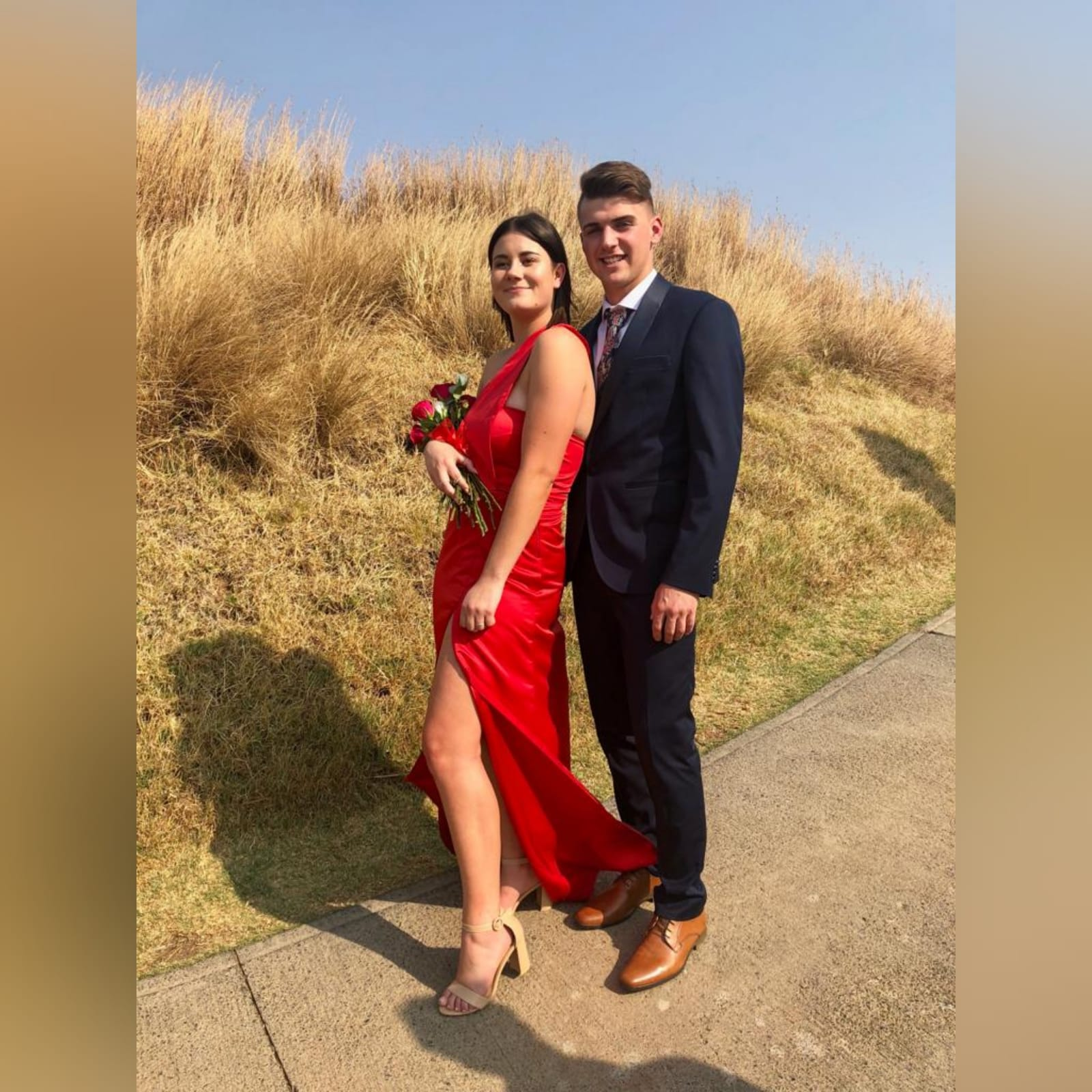 Bright red duchess satin single shoulder prom dress 1 bright red duchess satin single shoulder prom dress. Straight fit with a crossed slit.