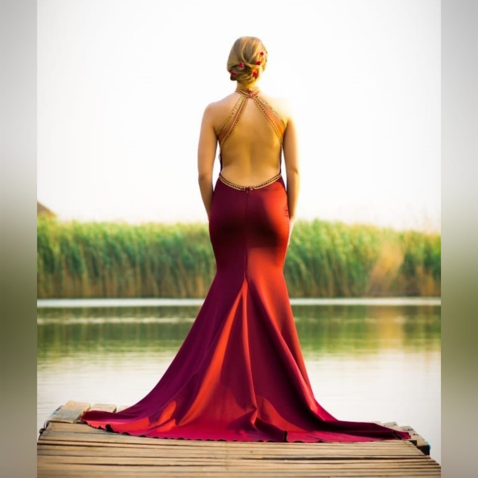 Maroon and gold matric farewell dress with a beaded bodice 4 maroon and gold matric farewell dress with a beaded bodice, low open back with beaded illusion straps. Illusion choker neckline detail with beads and diamante, with a slit and a train.