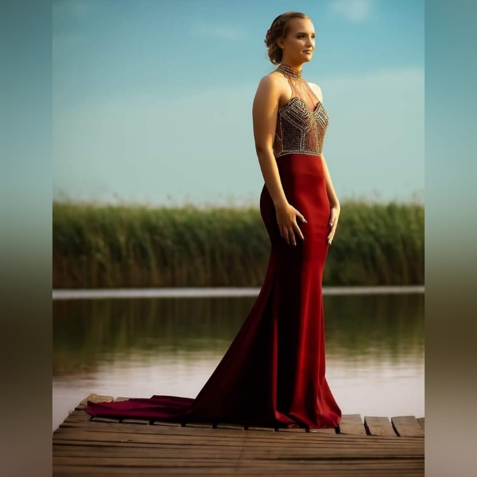 Maroon and gold matric farewell dress with a beaded bodice 2 maroon and gold matric farewell dress with a beaded bodice, low open back with beaded illusion straps. Illusion choker neckline detail with beads and diamante, with a slit and a train.